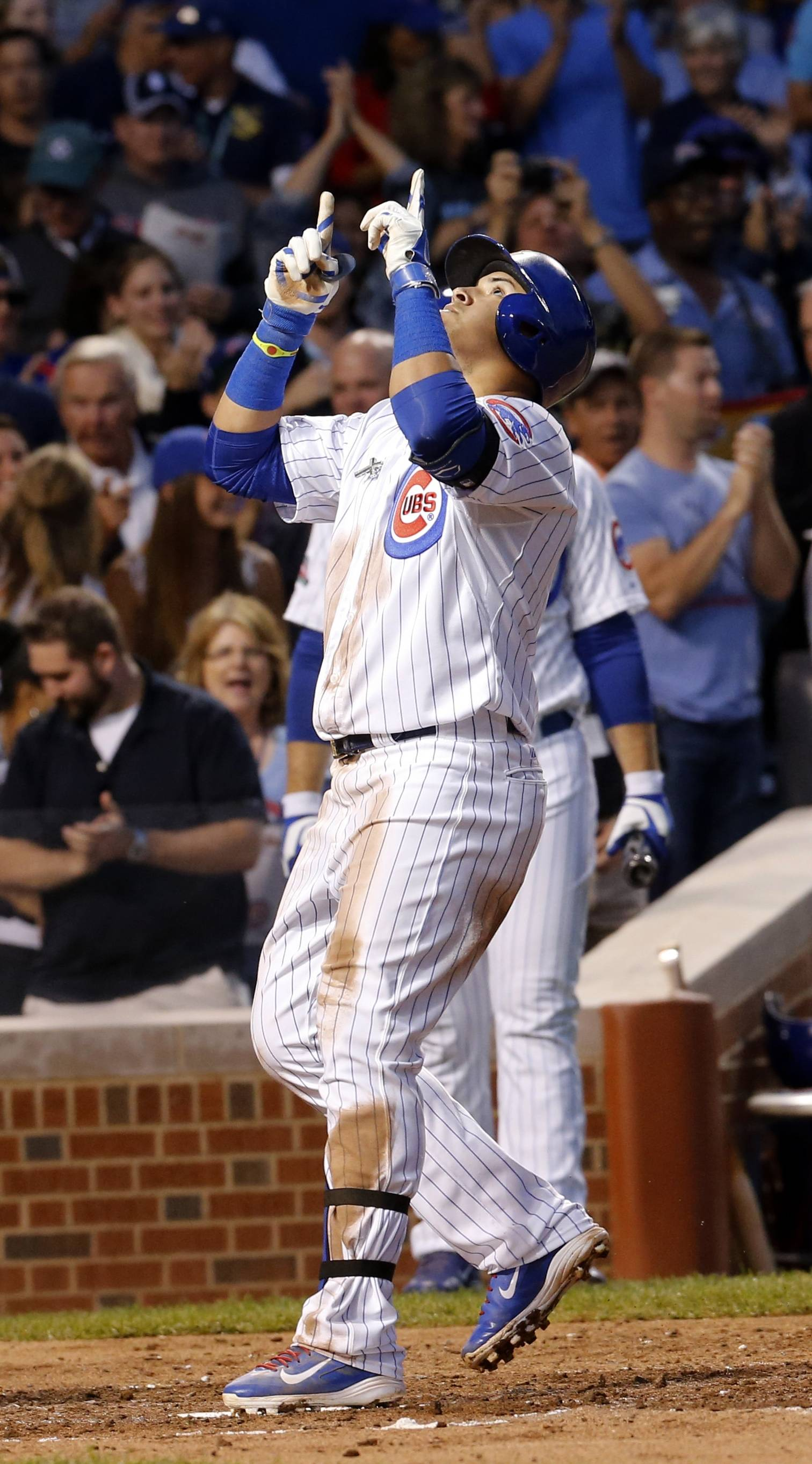 Javier Baez celebrates after hitting a home run, his first at Wrigley Field, during the third inning Wednesday night.