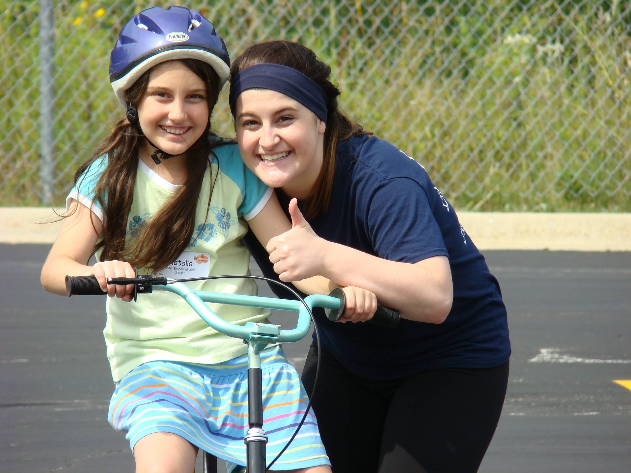 Montini Catholic High School senior, Mary Long, offers encouragement to new bikers at the iCan Bike event.Barbara Dawson