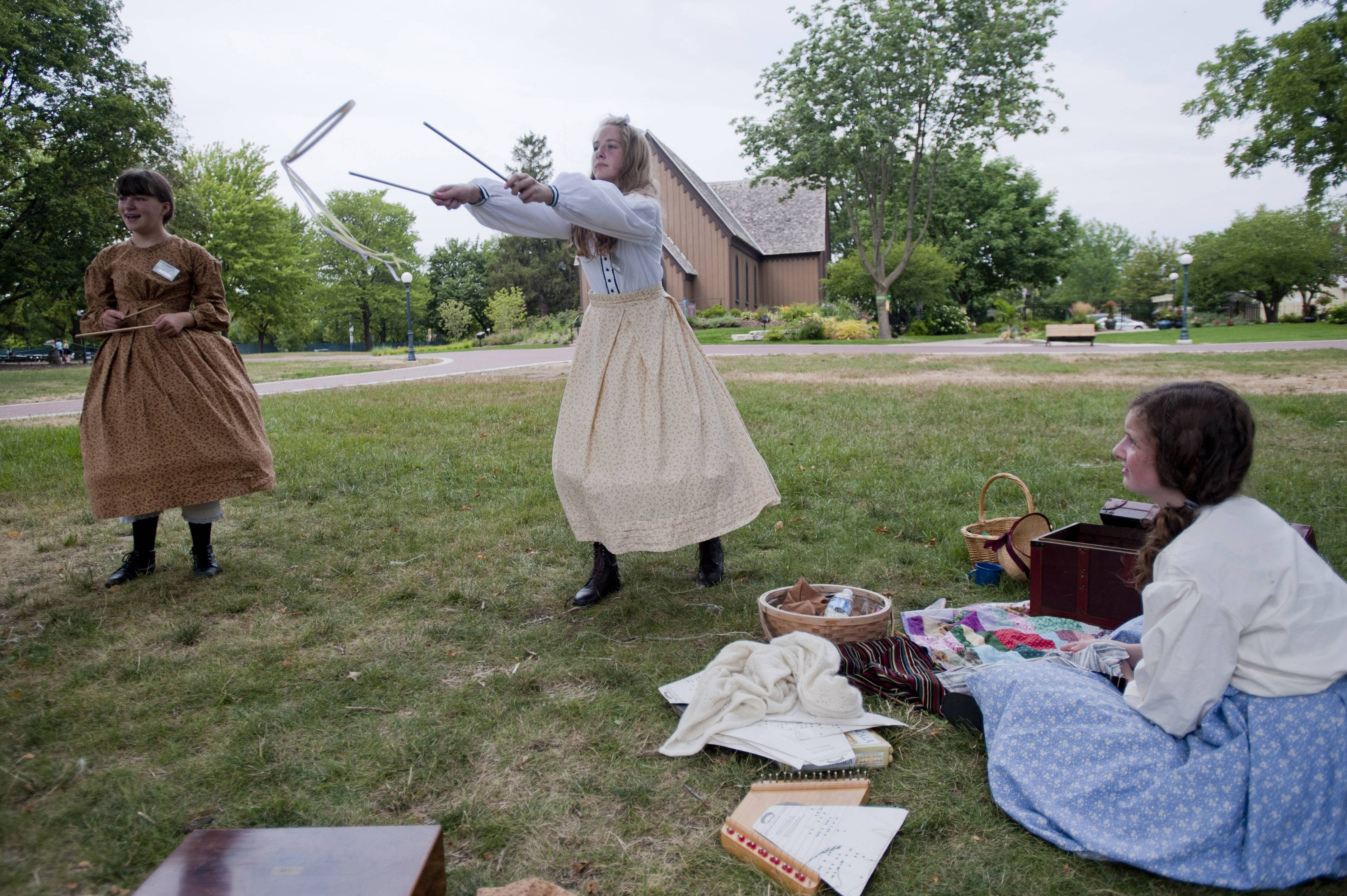 Children can test their skill at games that amused the children who first settled in Naperville during Naperville Plays! on Sunday at Naper Settlement.