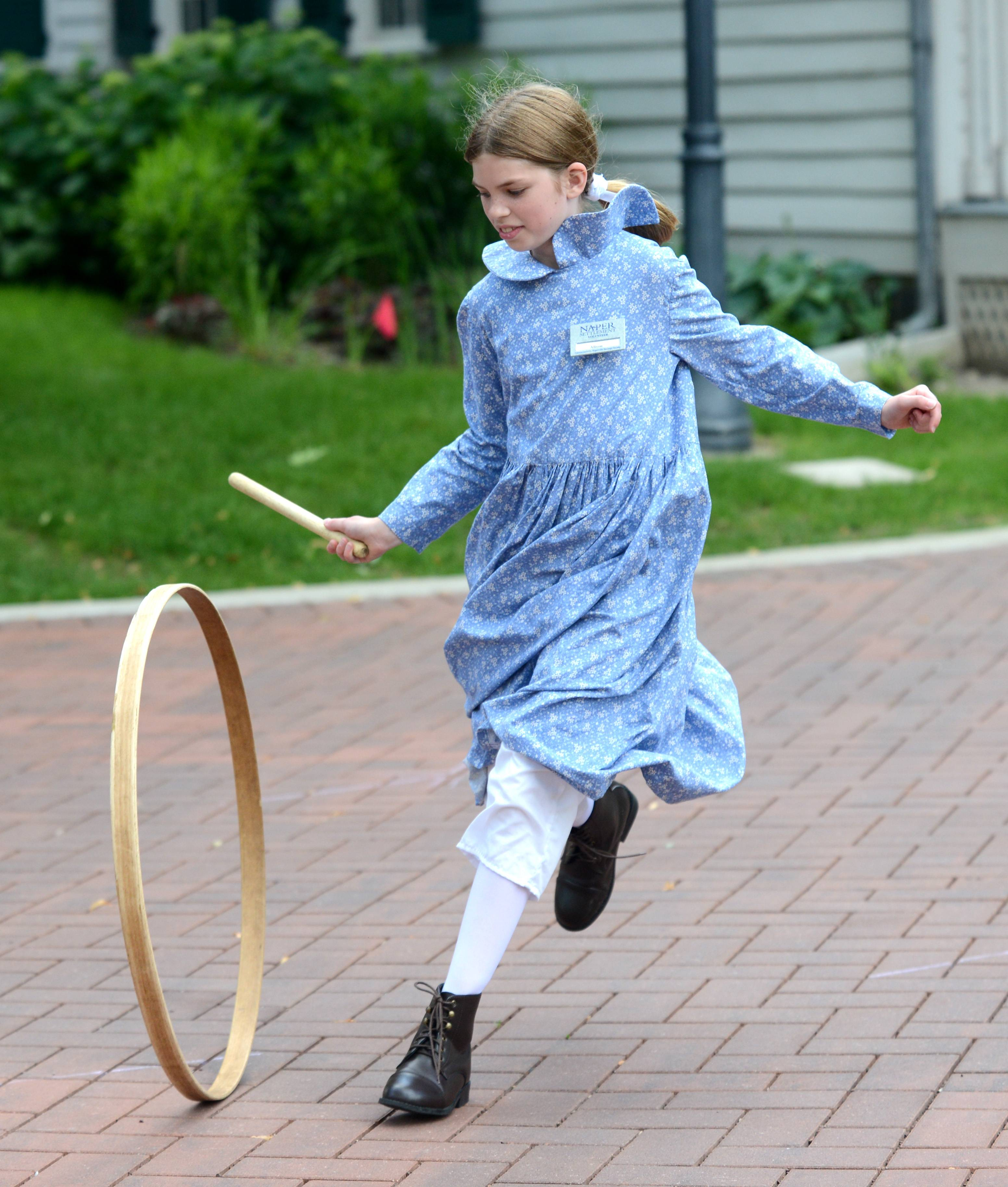 Hoop rolling, and even hula hooping, are among the games families can try during Naperville Plays!, an afternoon of vintage games and outdoor fun planned by Naper Settlement and DuPage Children's Museum.