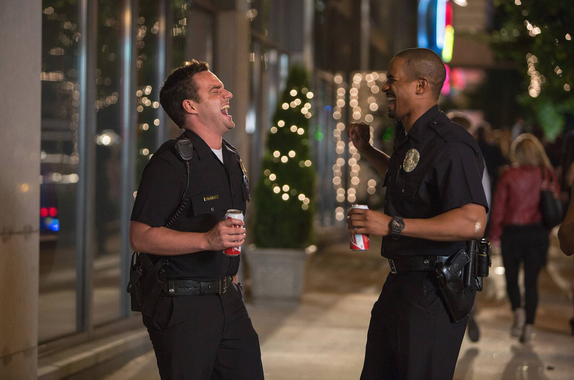 "Ryan (Jake Johnson, left) and Justin (Damon Wayans Jr.) take their LAPD Halloween costumes too far in ""Let's Be Cops."""