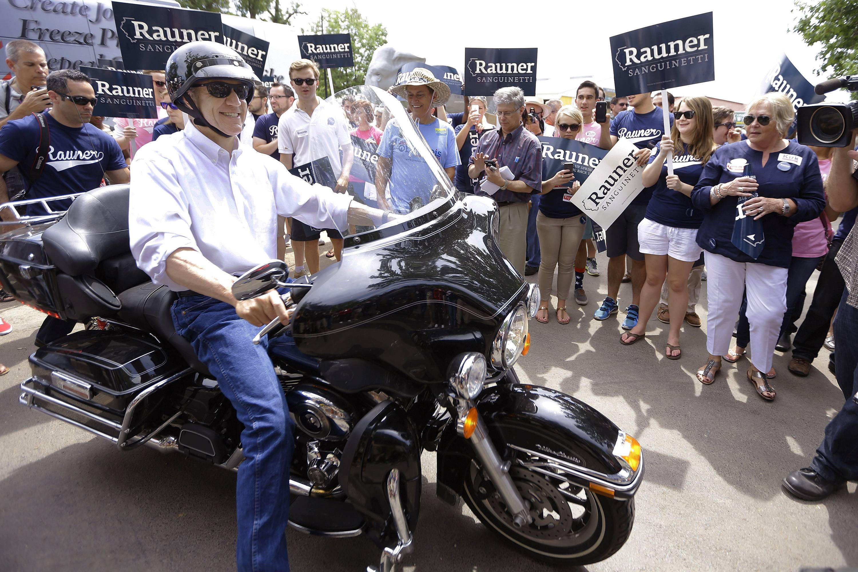 Republican gubernatorial candidate Bruce Rauner rides his Harley-Davidson motorcycle into the Illinois State Fairgrounds before participating in a Republican Day rally Thursday in Springfield.