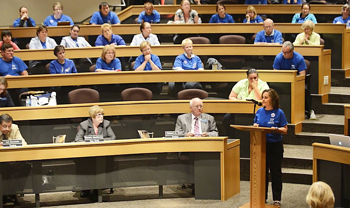 Vicki Bethke, president of the Support Staff of Elgin Community College Association, thanks trustees for their decision to keep the college's existing custodial workers at a June meeting.