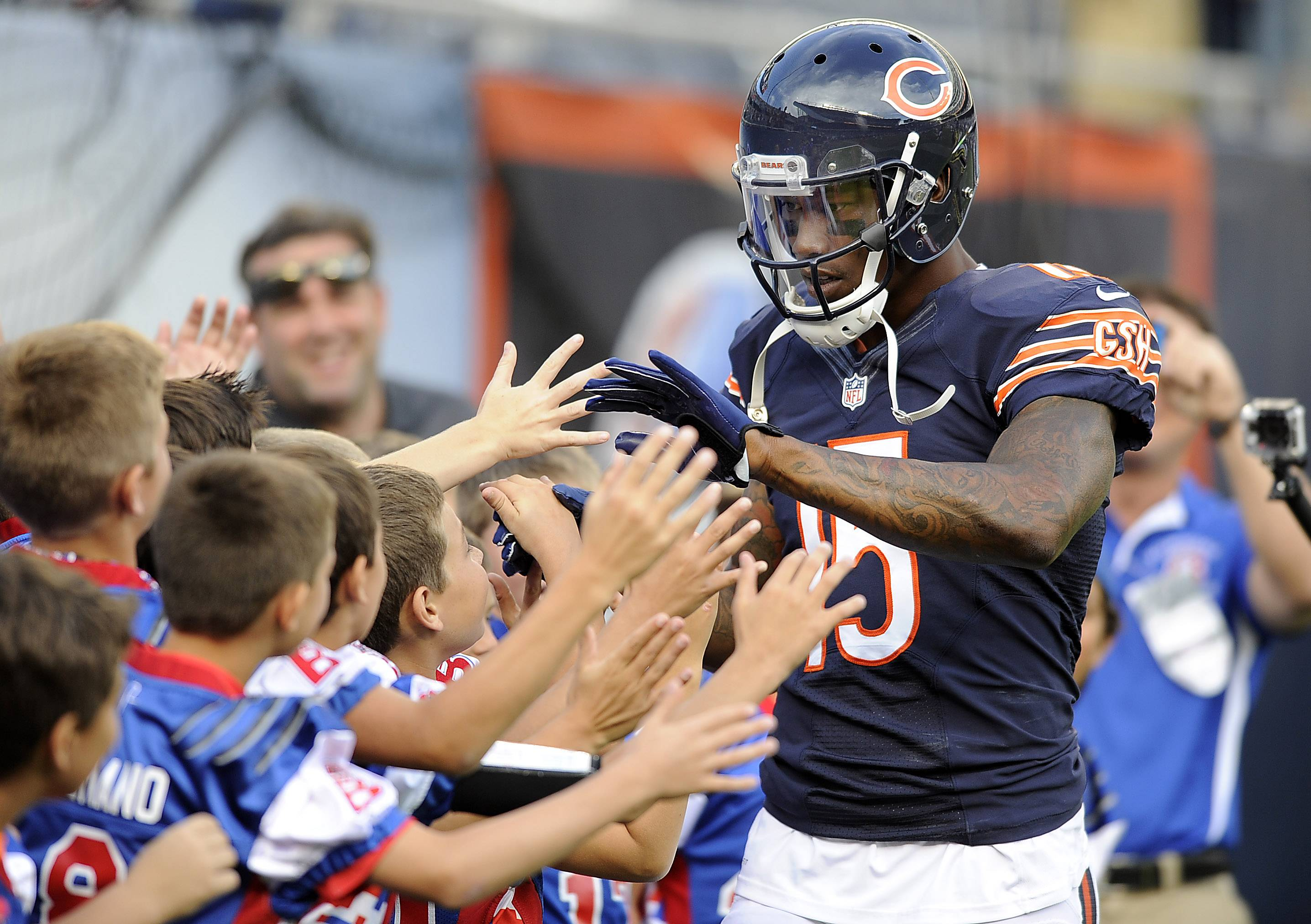 Chicago Bears' Brandon Marshall greets youngsters before the game.