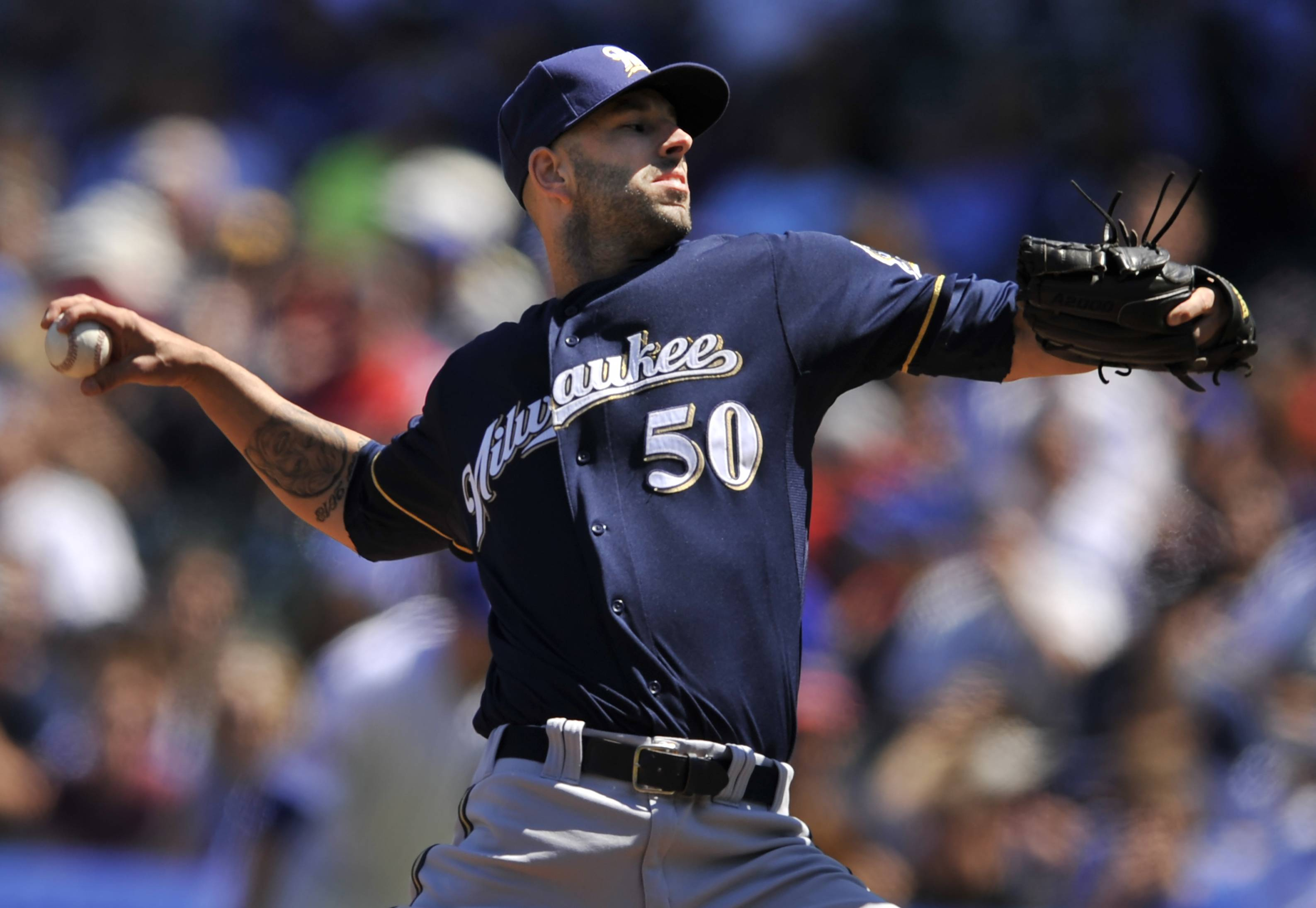 Milwaukee Brewers starter Mike Fiers delivers a pitch during the first inning of a baseball game against the Cubs in Chicago Thursday.
