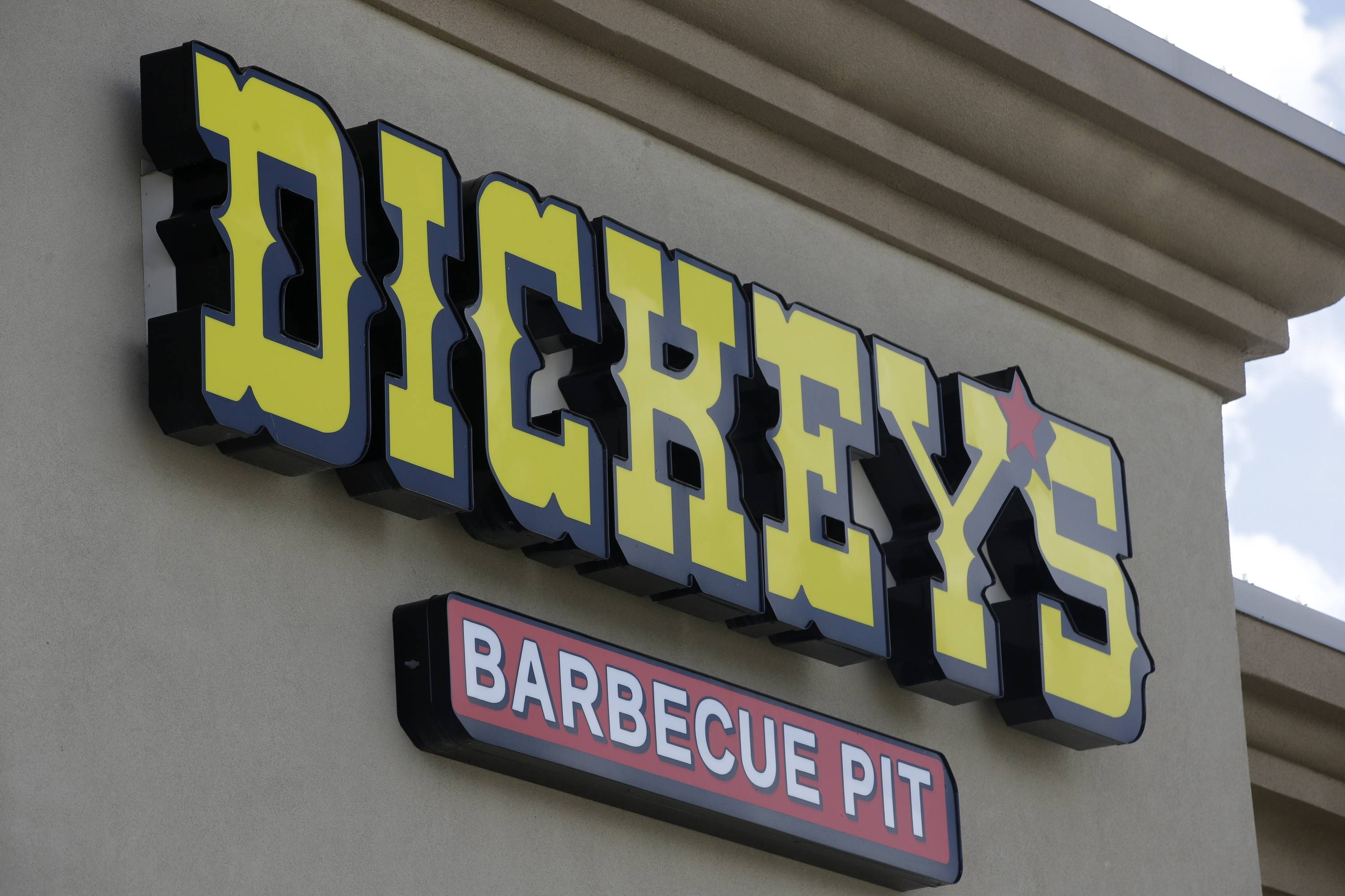 A sign at Dickey's Barbecue Pit Thursday in South Jordan, Utah. Police say a woman was in extremely critical condition after drinking sweet tea laced with an industrial cleaning chemical at the restaurant.