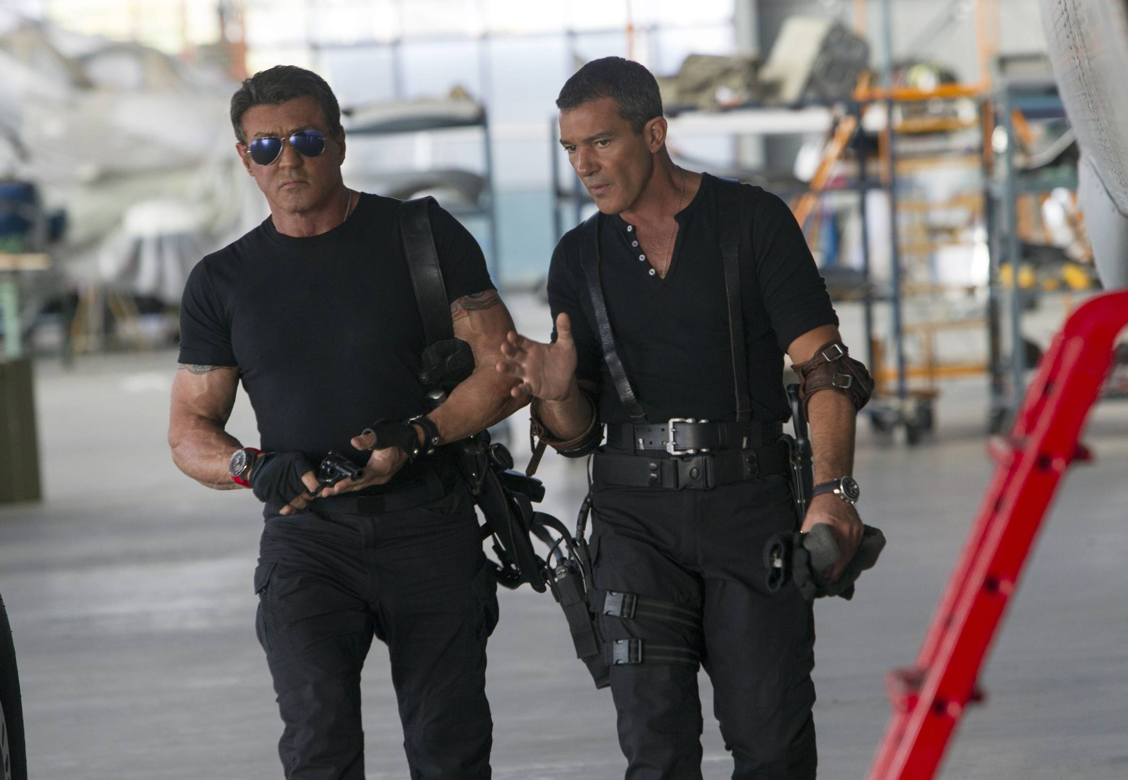 "Team leader Barney (Sylvester Stallone), left, isn't sure if he wants out-of-work assassin Galgo (Antonio Banderas) working for him ""Expendables 3."""