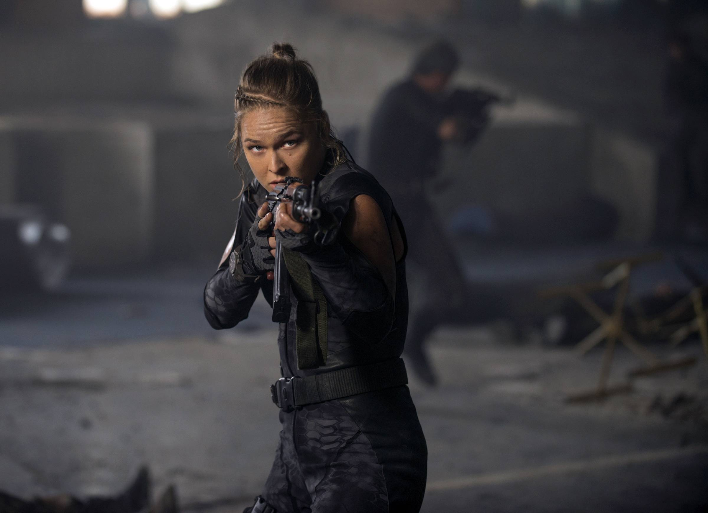 "Bouncer Luna (Ronda Rousey) has to prove her mettle in ""Expendables 3."""