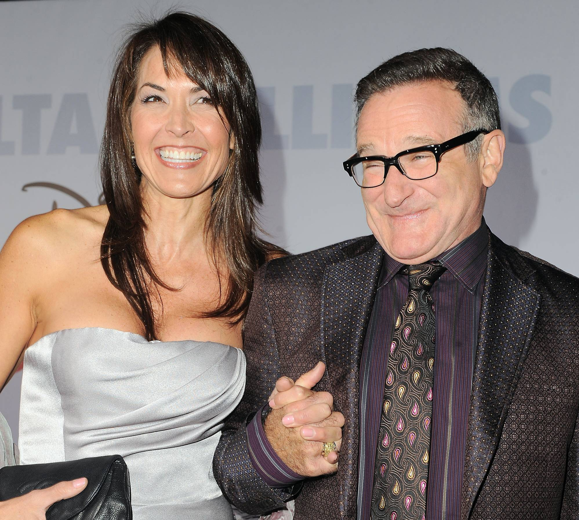 "This Nov. 9, 2009, file photo shows actor Robin Williams, right, and his wife, Susan Schneider, at the premiere of ""Old Dogs"" in Los Angeles."
