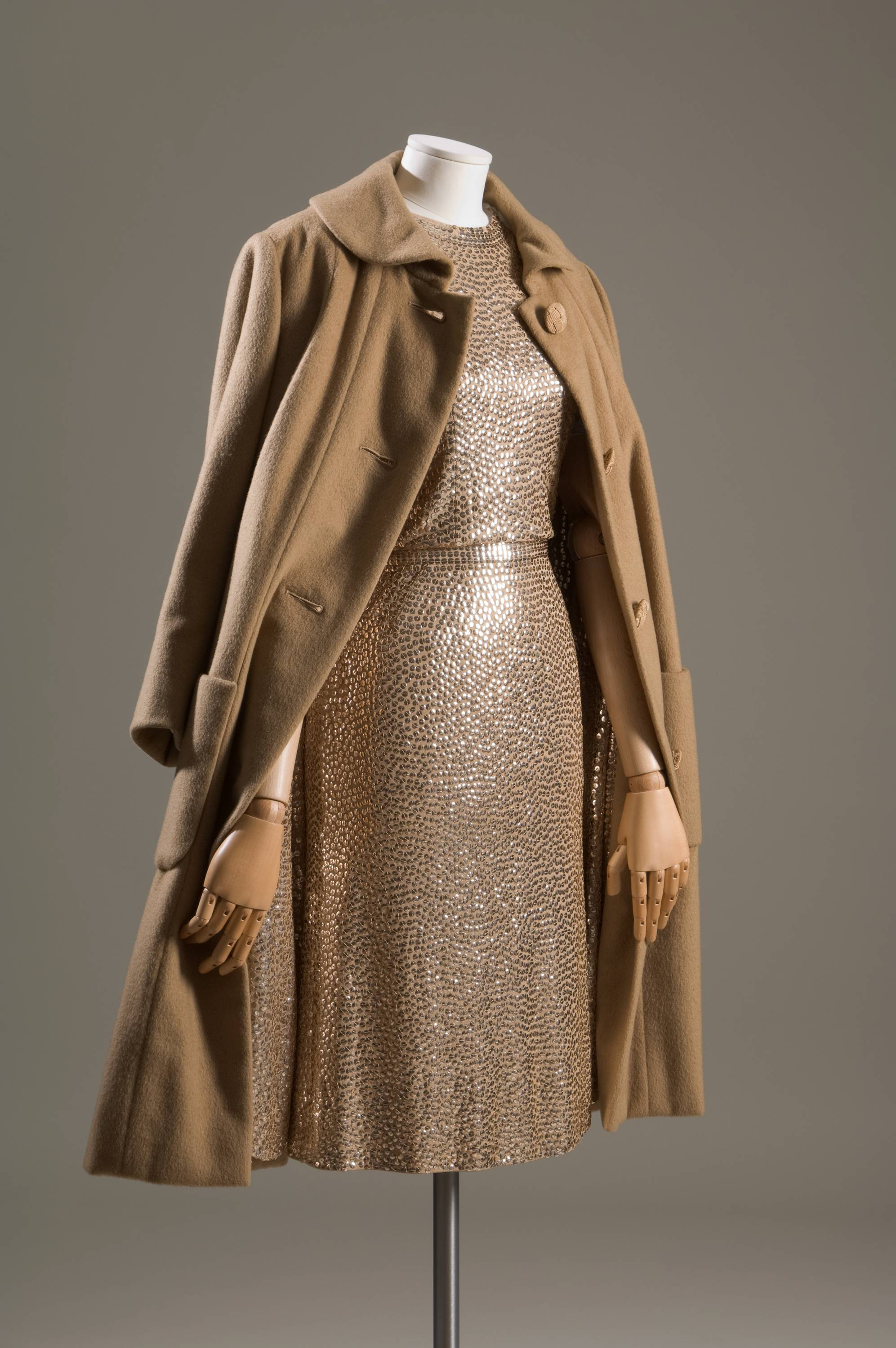 "Lauren Bacall's fashion sense was such that she wore the outfit, not the other way around. This gold sequined camel silk jersey ""mermaid"" sheath dress and cashmere straight line ""subway coat"" with sequined lining will be on display at the Museum of Fashion Institute of Technology."