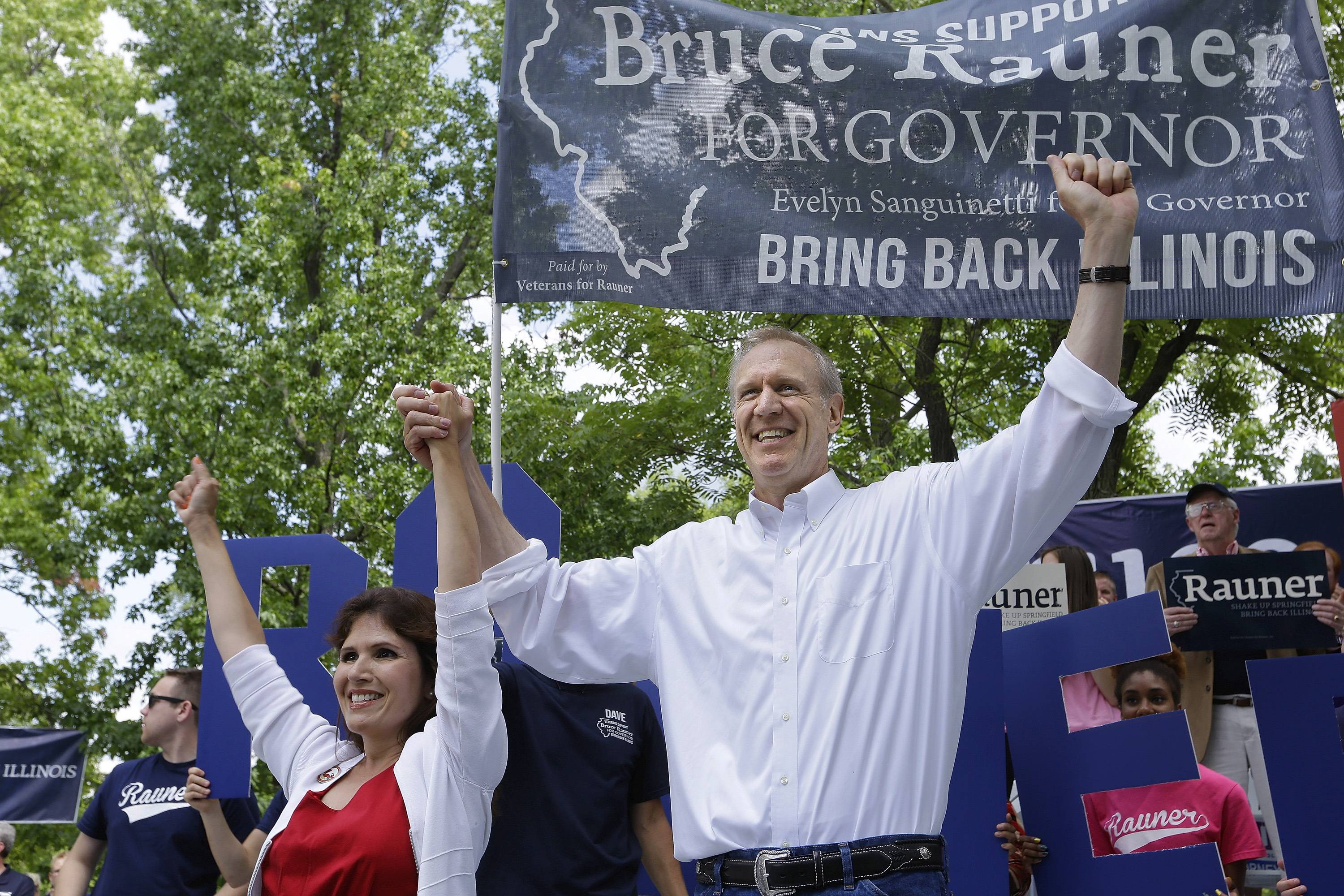 Governor candidate Bruce Rauner and his running mate, Evelyn Sanguinetti of Wheaton, participate in a Republican Day rally Thursday at the Illinois State Fair in Springfield.