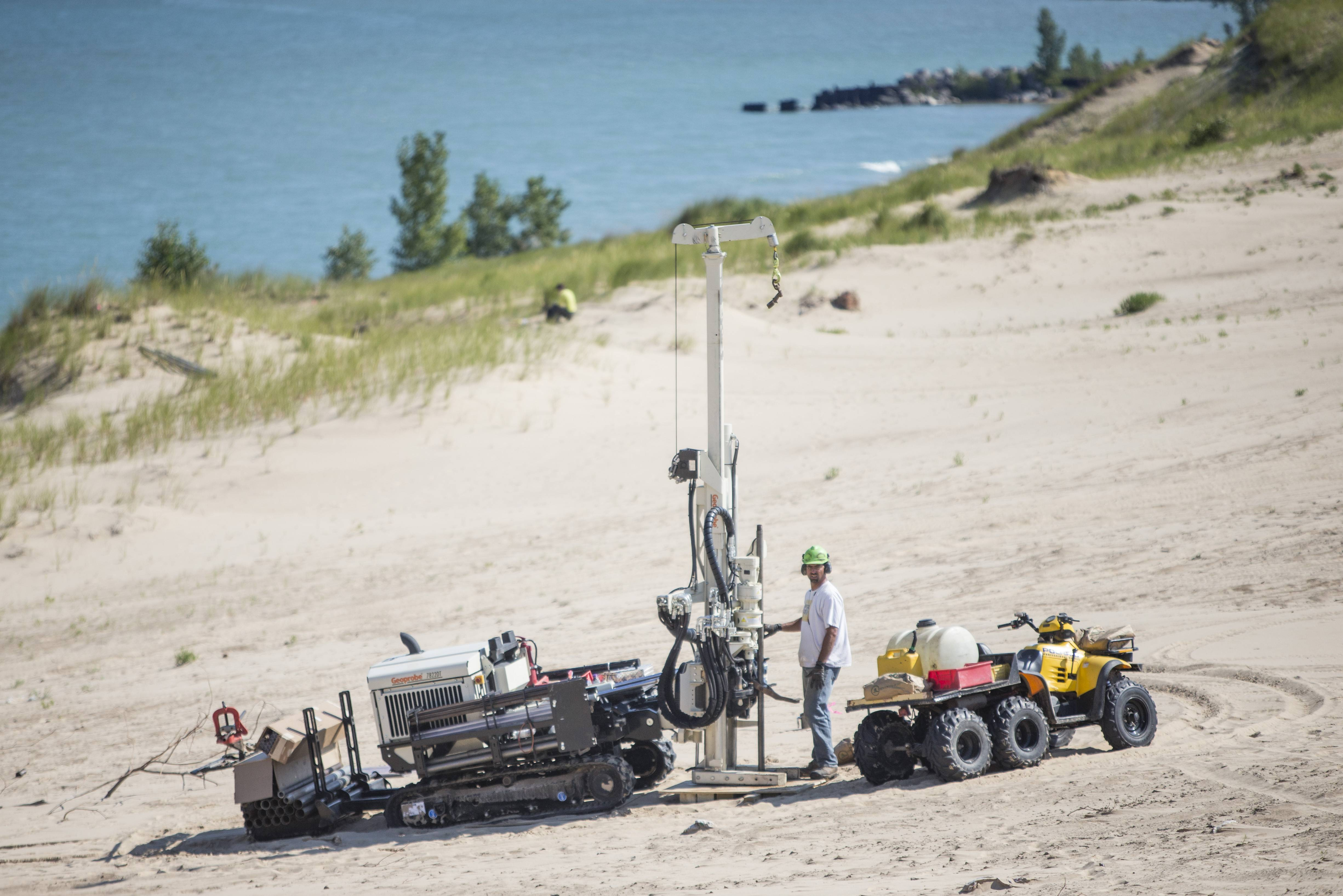 A researcher uses large equipment to study Indiana Dunes National Lakeshore's Mount Baldy on Thursday in Michigan City, Ind. The dune has been closed for 13 months.