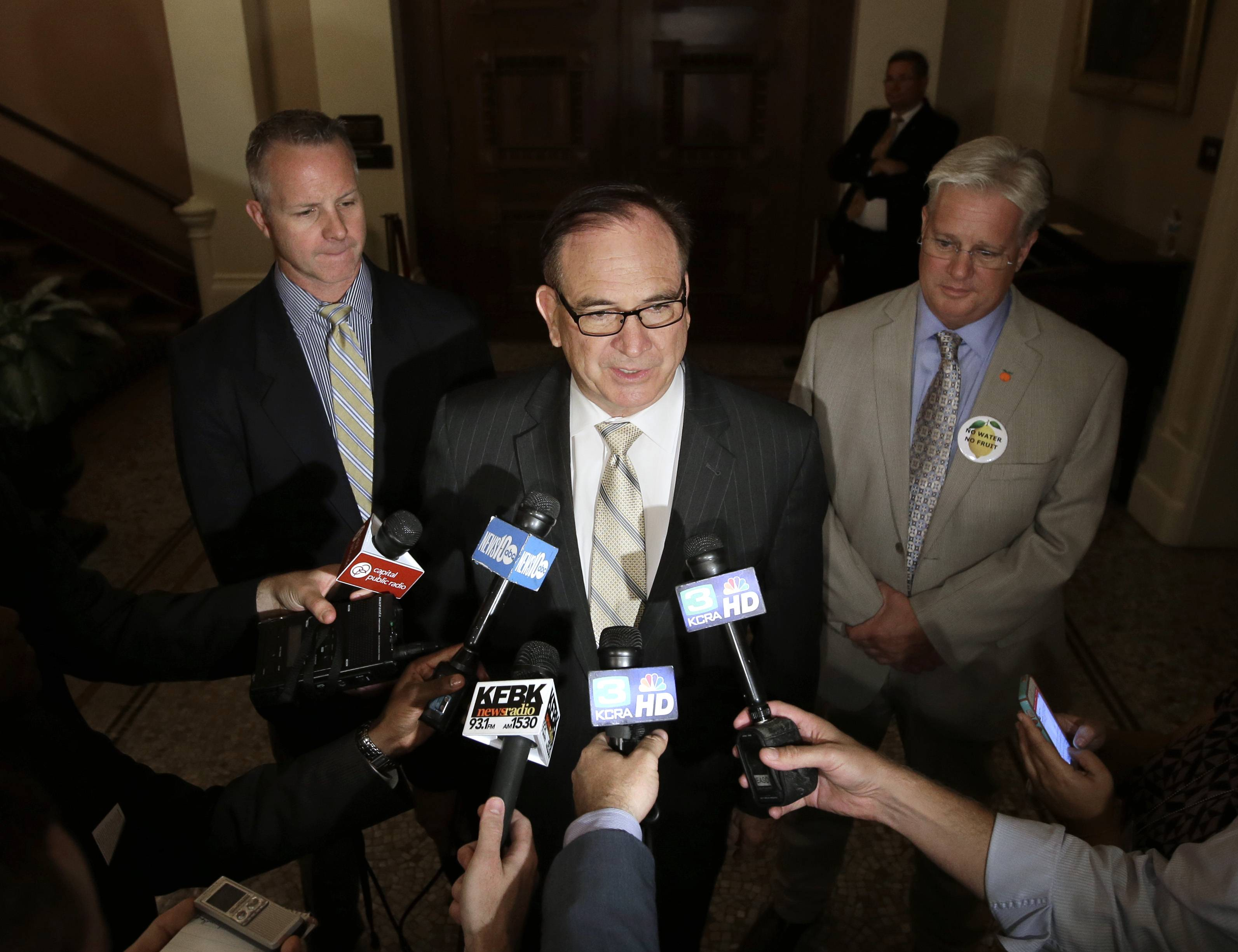 Senate Minority Leader Bob Huff, R-Diamond Bar, center, accompanied by GOP Sens. Anthony Canella, of Ceres, left, and Andy Vidak, of Hanford, tells reporters that his caucus would provide enough votes to pass a compromise water bond measure in Sacramento, Calif. on Wednesday, Aug. 13, 2014. The $7.5 billion compromise bond proposal emerged after hours of negotiations between Gov. Jerry Brown and legislative leaders from both parties.