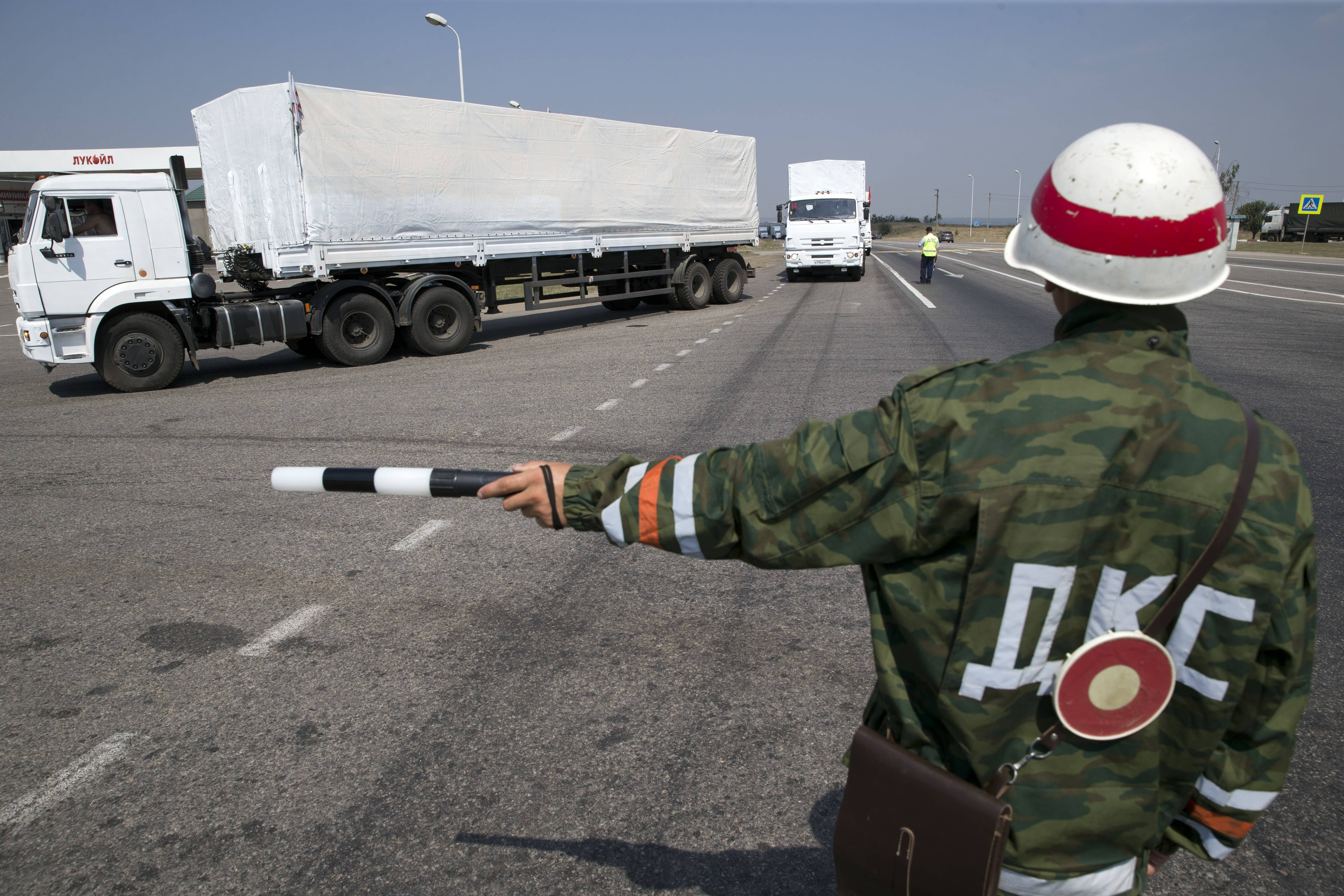 A convoy of white trucks with humanitarian aid is seen at the Ukrainian border in Rostov-on-Don region, Russia, Thursday, Aug. 14, 2014.