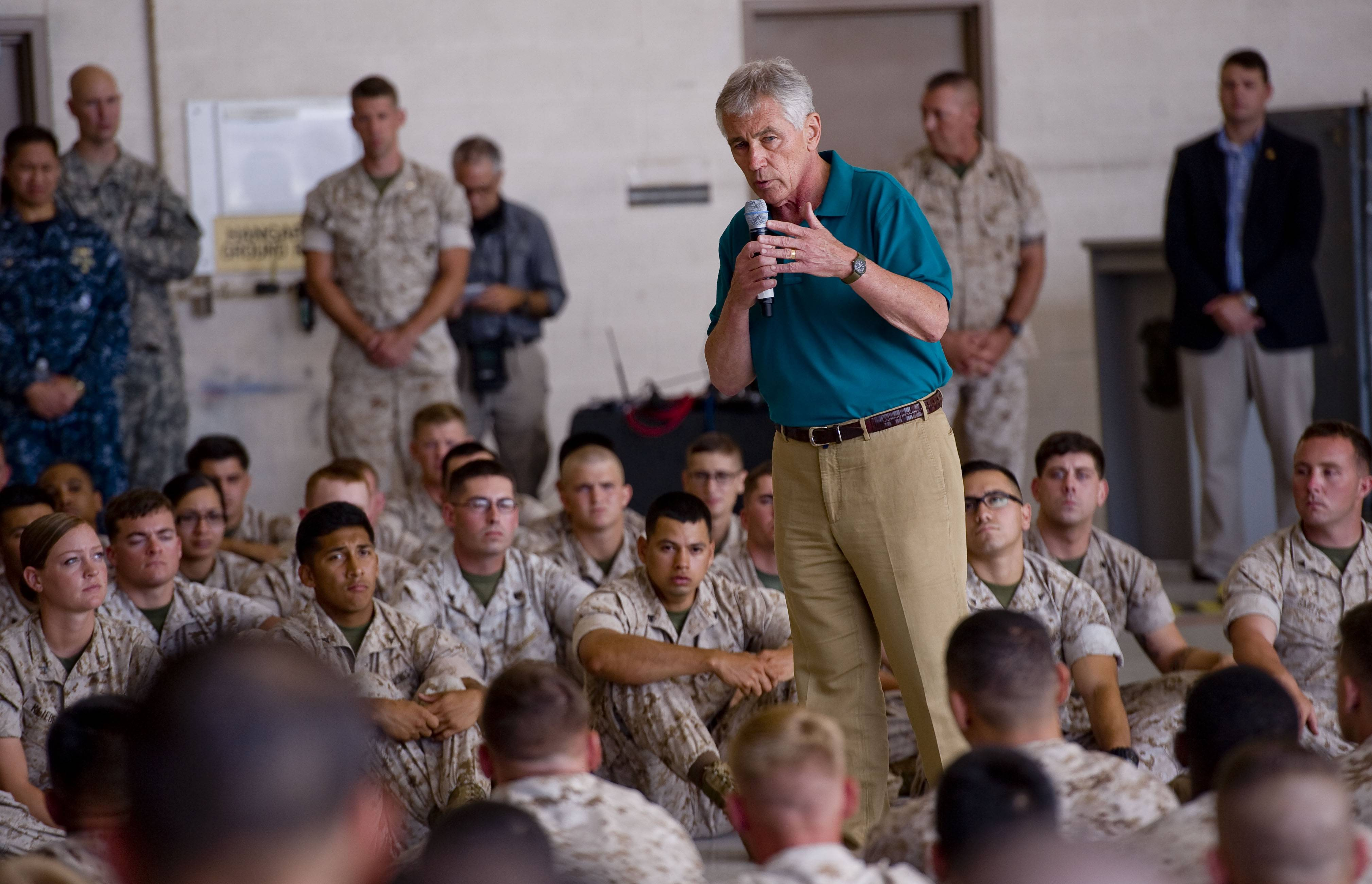 Secretary of Defense Chuck Hagel addresses the Marines assembled in a hangar at Camp Pendleton on Tuesday Aug. 12, 2014.