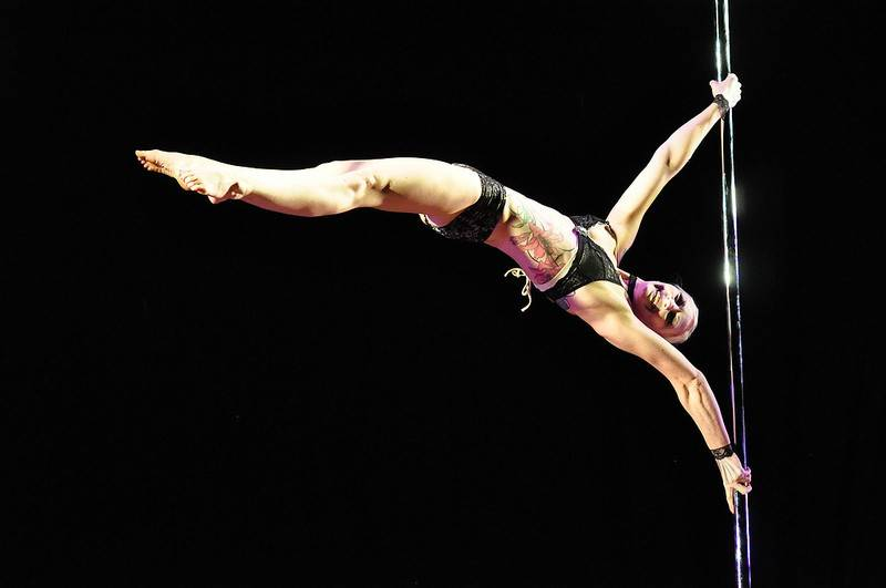 Looking more like a gymnast or acrobat, Becca Buck shows off the form that won her the Midwest Elite Division Pole Performer of the Year title during last year's pole-dancing championships.