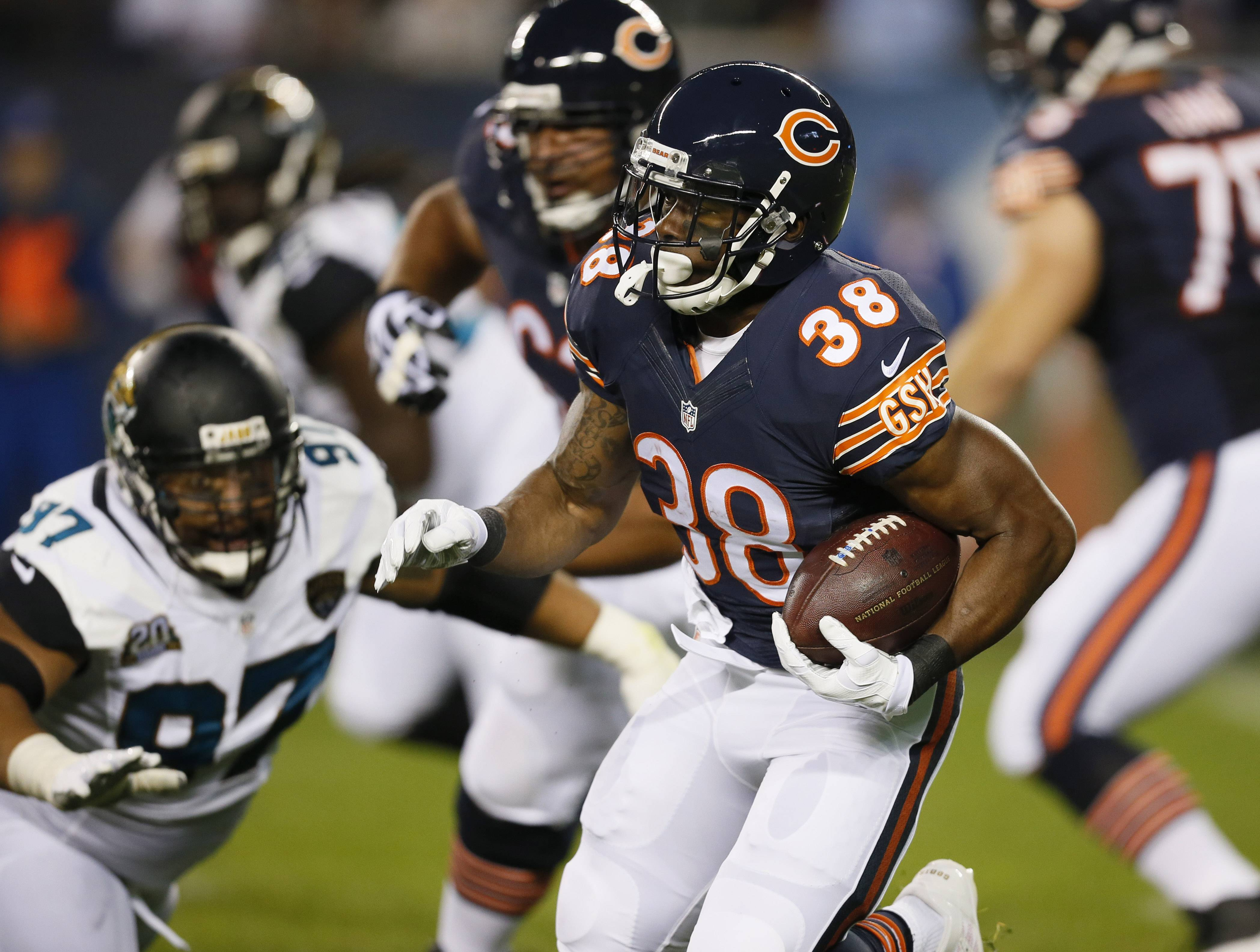 Associated PressBears running back Shaun Draughn (38) rushes against the Jacksonville Jaguars during the first half of an NFL preseason football game in Chicago Thursday.