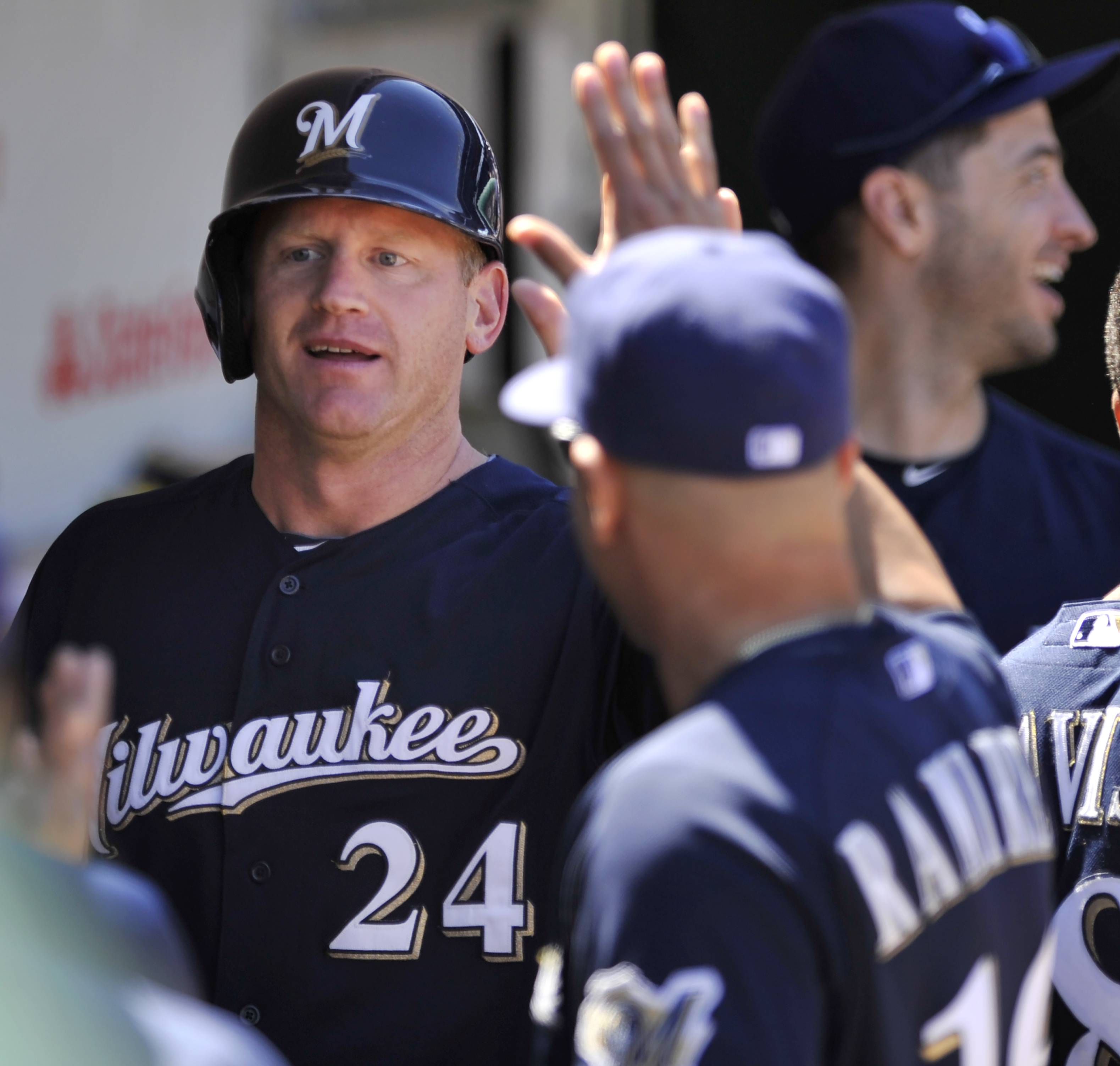 The Milwaukee Brewers' Lyle Overbay celebrates Thursday with teammates  after scoring on a Elian Herrera triple during the fourth inning at Wrigley Field.
