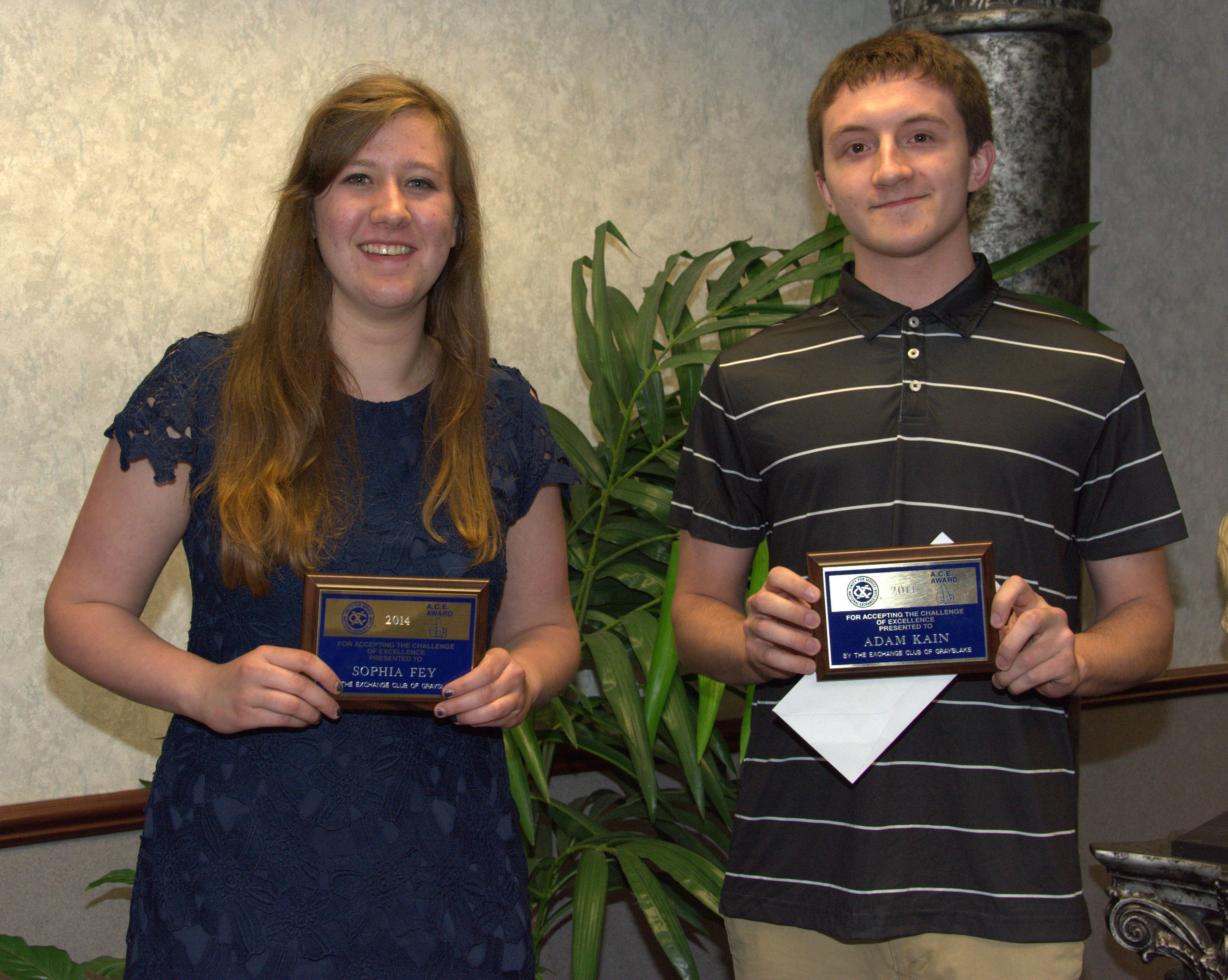 Sofia Fey and Adam Kain with their ACE Awards, earned by overcoming obstacles to pursue their high school careers.