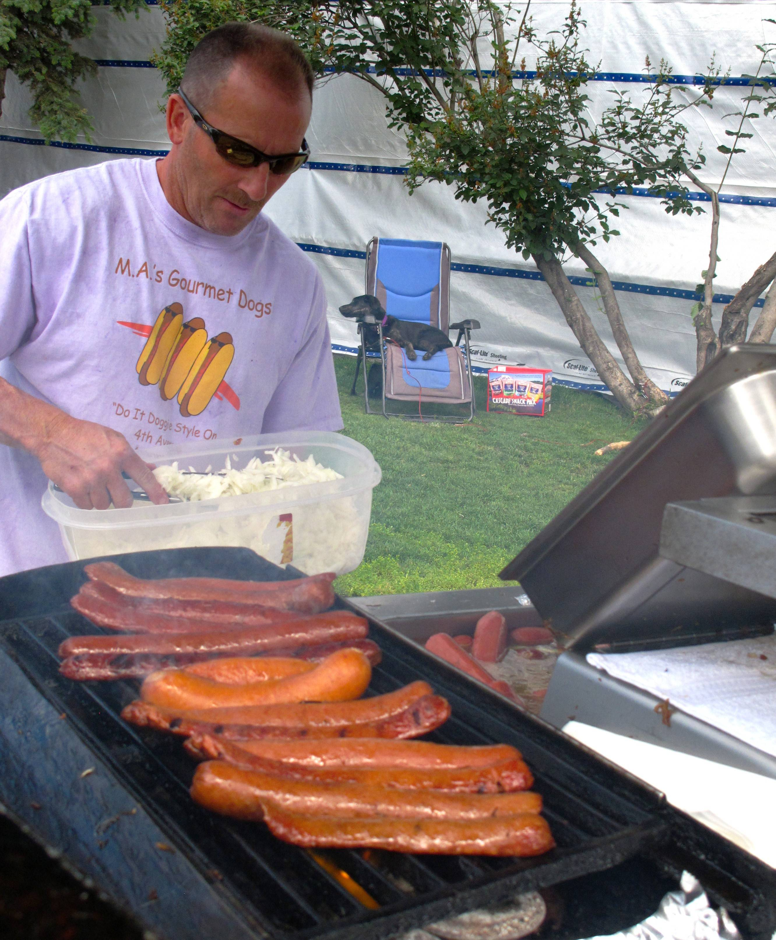 Michael Anderson operates his popular hot dog stand, where spicy reindeer dogs are the hands-down crowd favorite in downtown Anchorage, Alaska.
