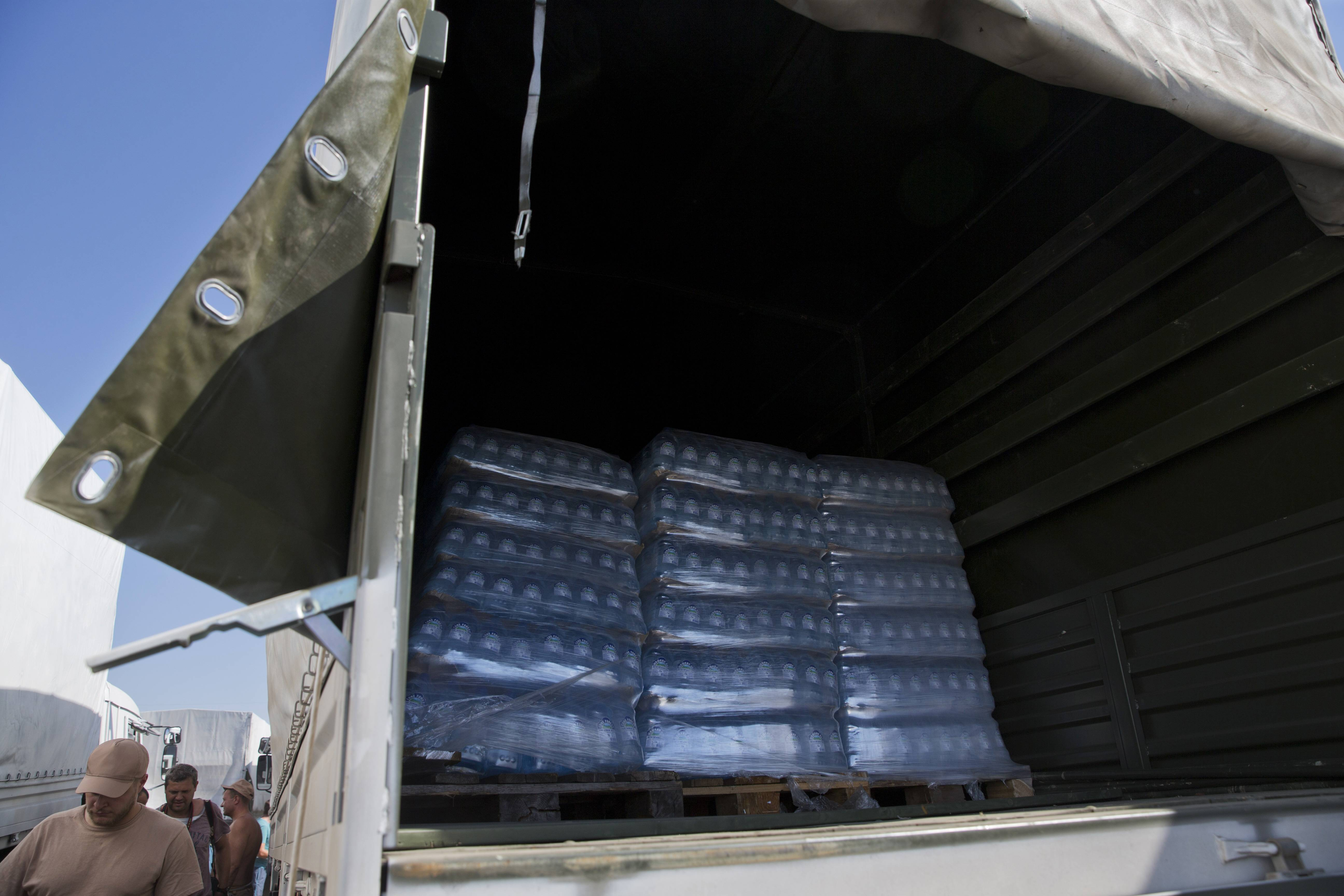 Bottles with water are placed in the back of a truck as Russian Ministry of Emergency Situation decided to show the aid convoy to journalists in Voronezh, about 28 kilometers (17 miles) from Ukrainian border, Rostov-on-Don region, Russia, Friday, Aug. 15, 2014.