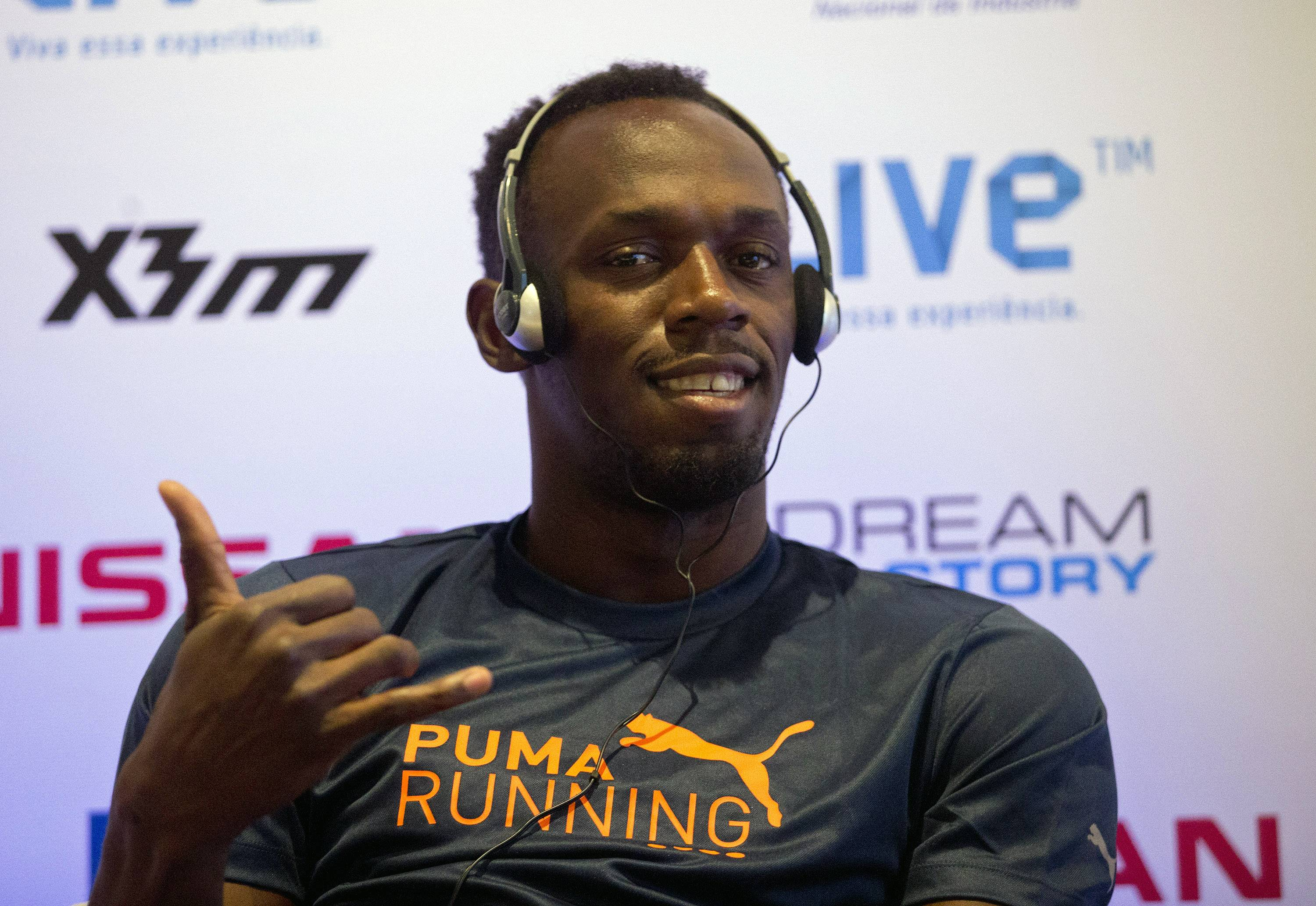Jamaican Usain Bolt strikes a pose during a news conference Friday promoting the 'Mano a Mano' challenge in Rio de Janeiro, Brazil.