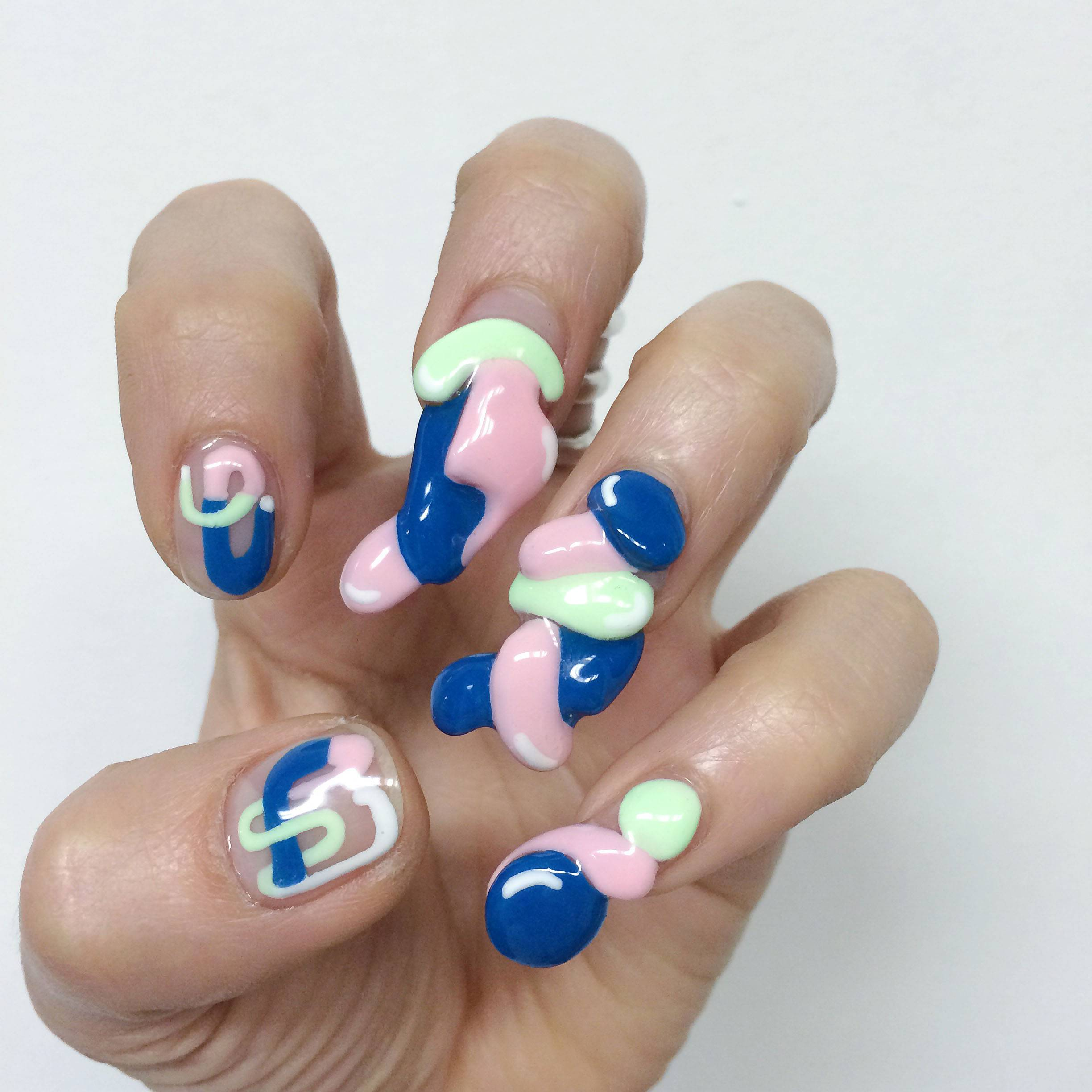 "These 3-D fingernail designs by Miho ""Mei"" Kawajiri give an added dimension to nails."