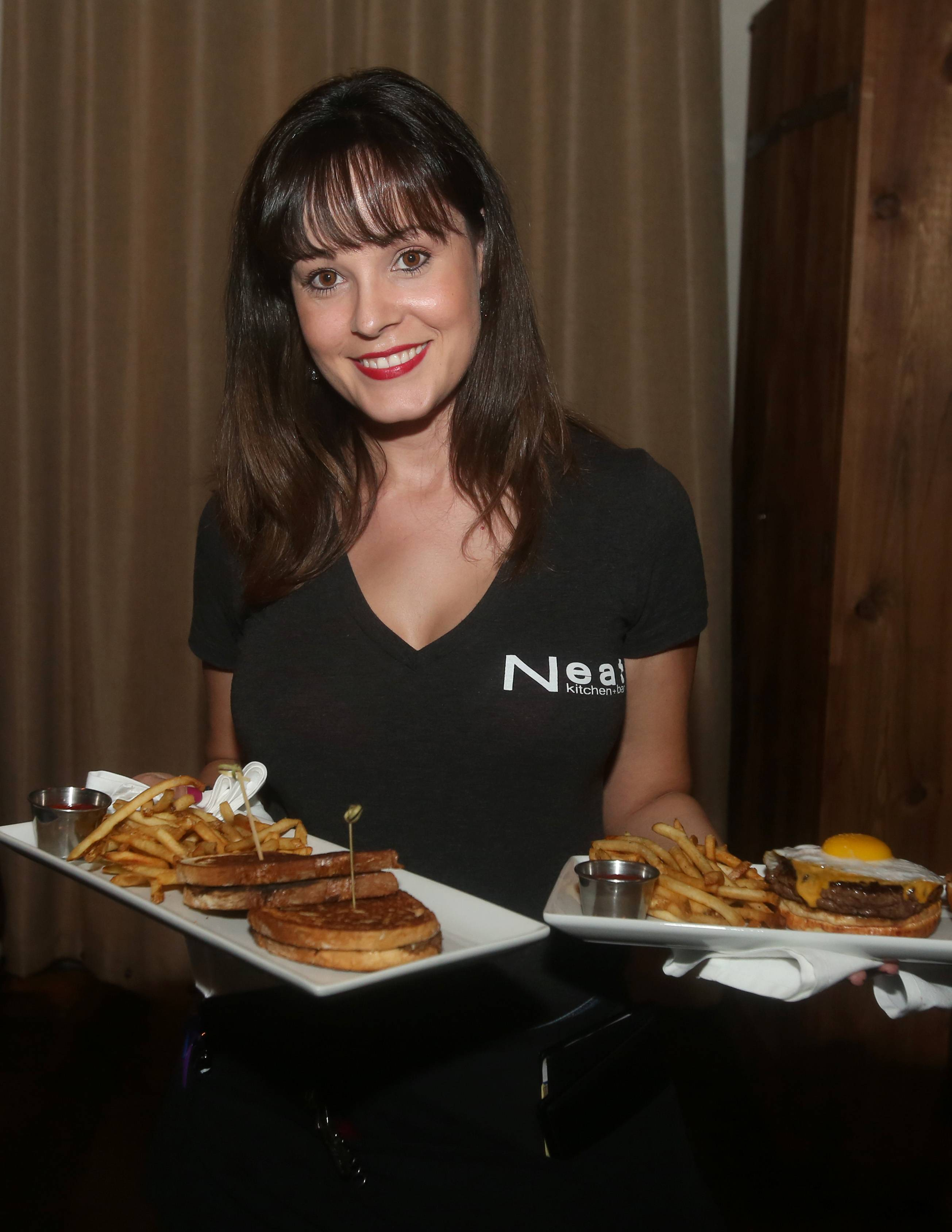 Ely Kritikos serves customers at Neat Kitchen & Bar in Westmont.