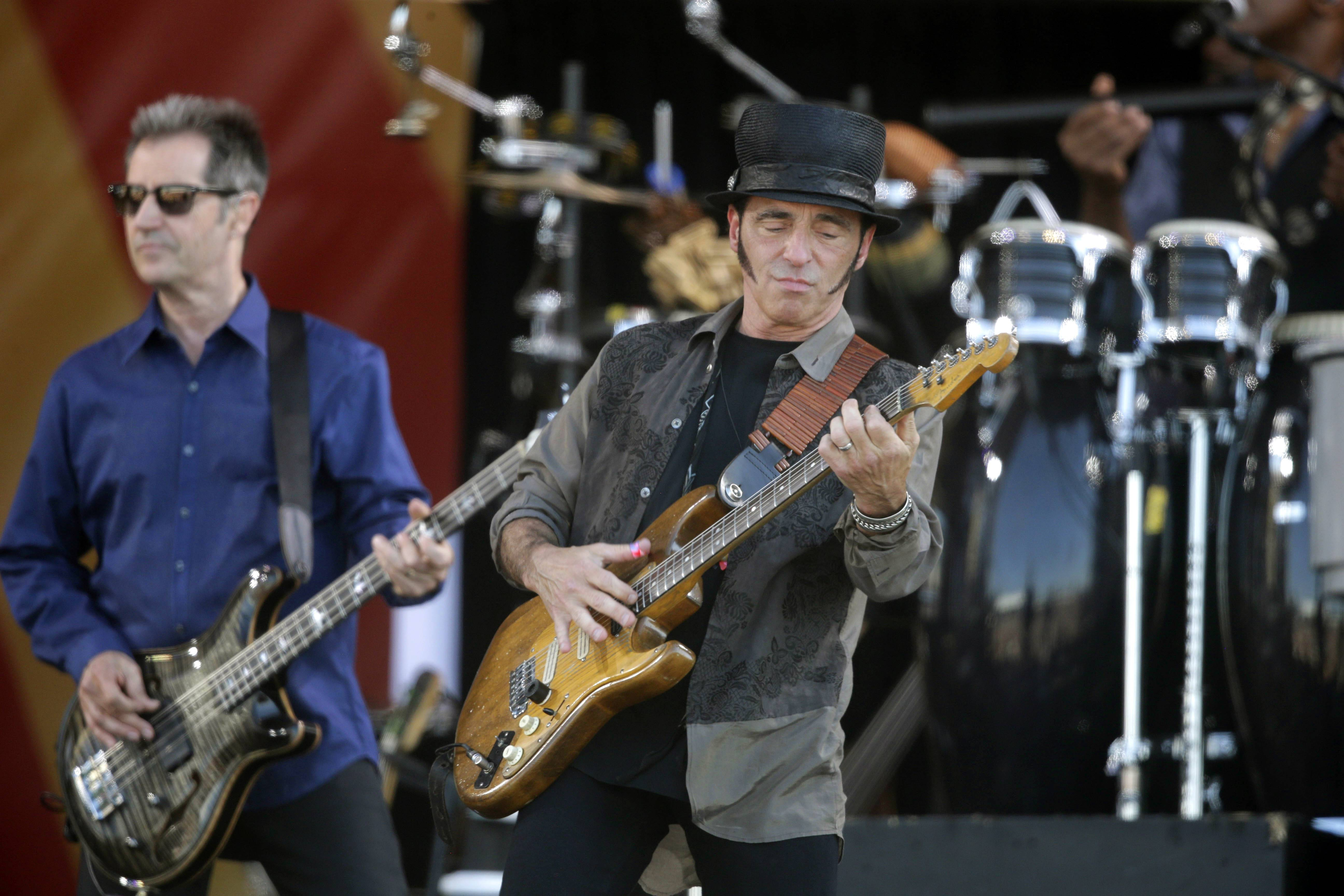 Nils Lofgren, center, performed with Bruce Springsteen and the E Street Band at the New Orleans Jazz and Heritage Festival in May. Lofgren has forged a relatively unique rock 'n' roll niche through a willingness to sublimate his ego and take on supporting roles with Springsteen, Neil Young and Ringo Starr in addition to writing and recording his own music.