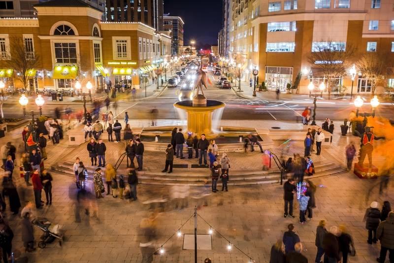 People Enjoy Town Center At Night In Virginia Beach