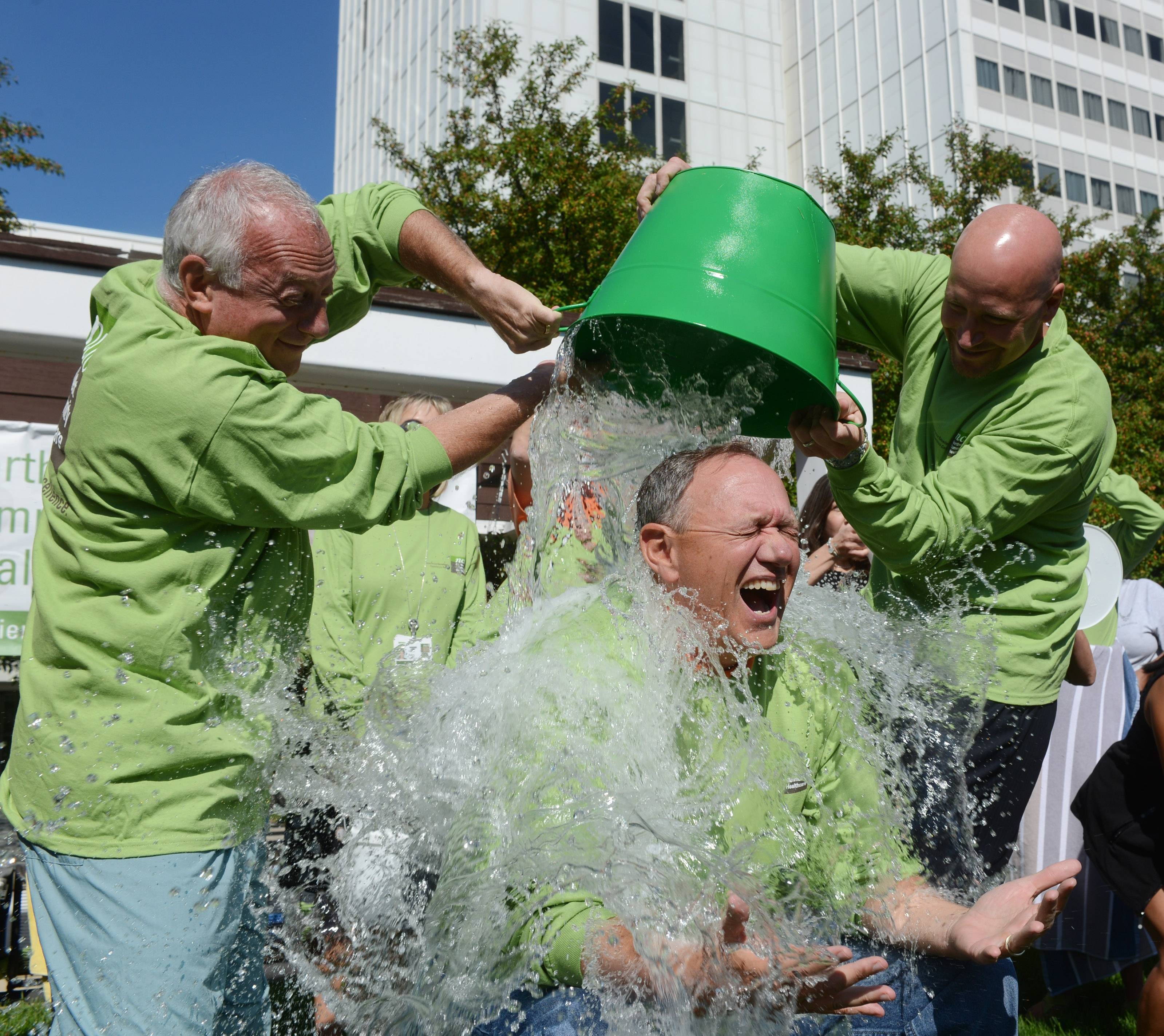Northwest Community Hospital CEO Stephen Scogna gets doused by Dr. Alan Loren and Chief Operating Officer Michael Hartke, right.
