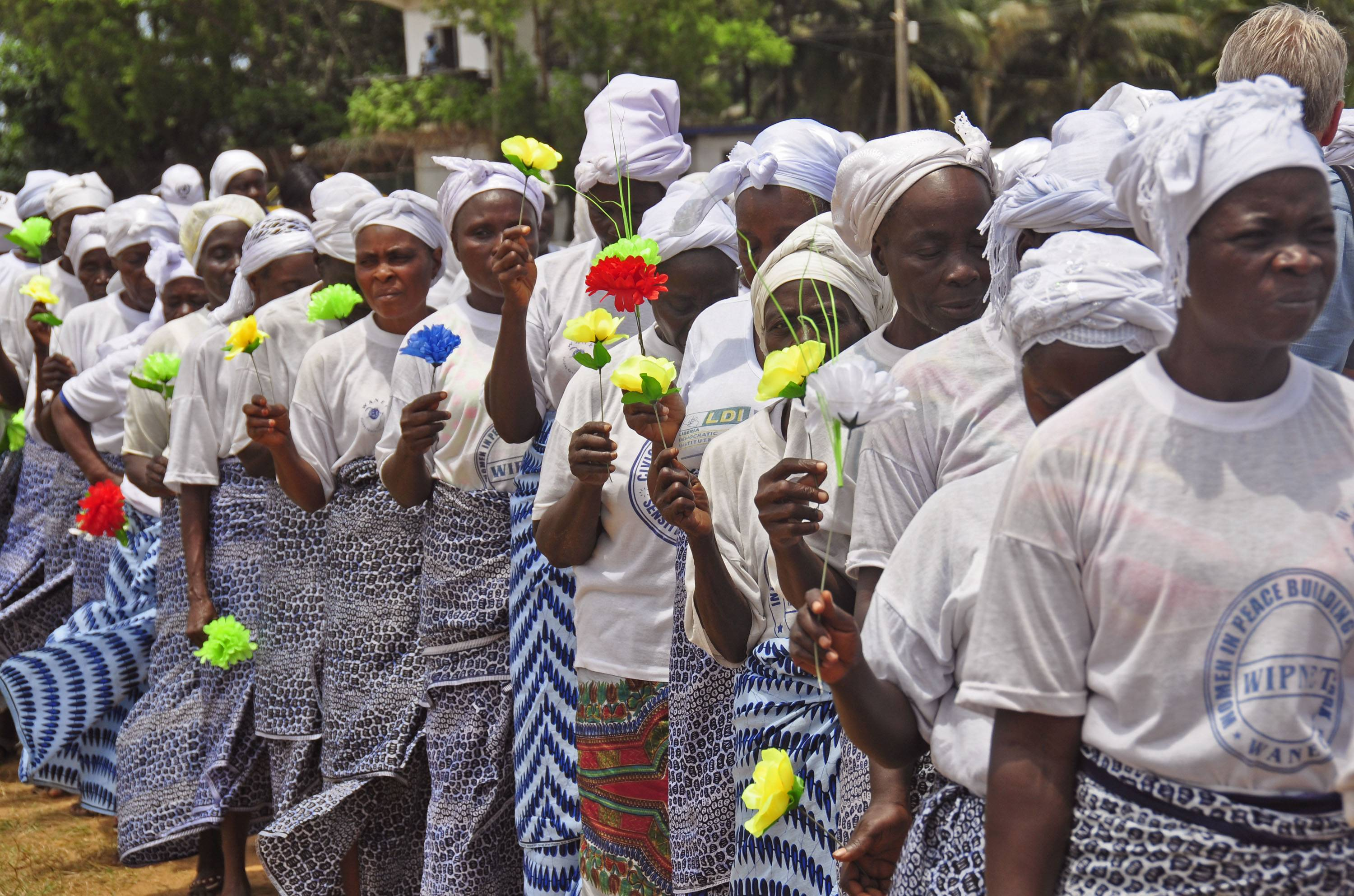 Liberia women walk Thursday after  praying for help with the Ebola virus, in the city of  Monrovia, Liberia.