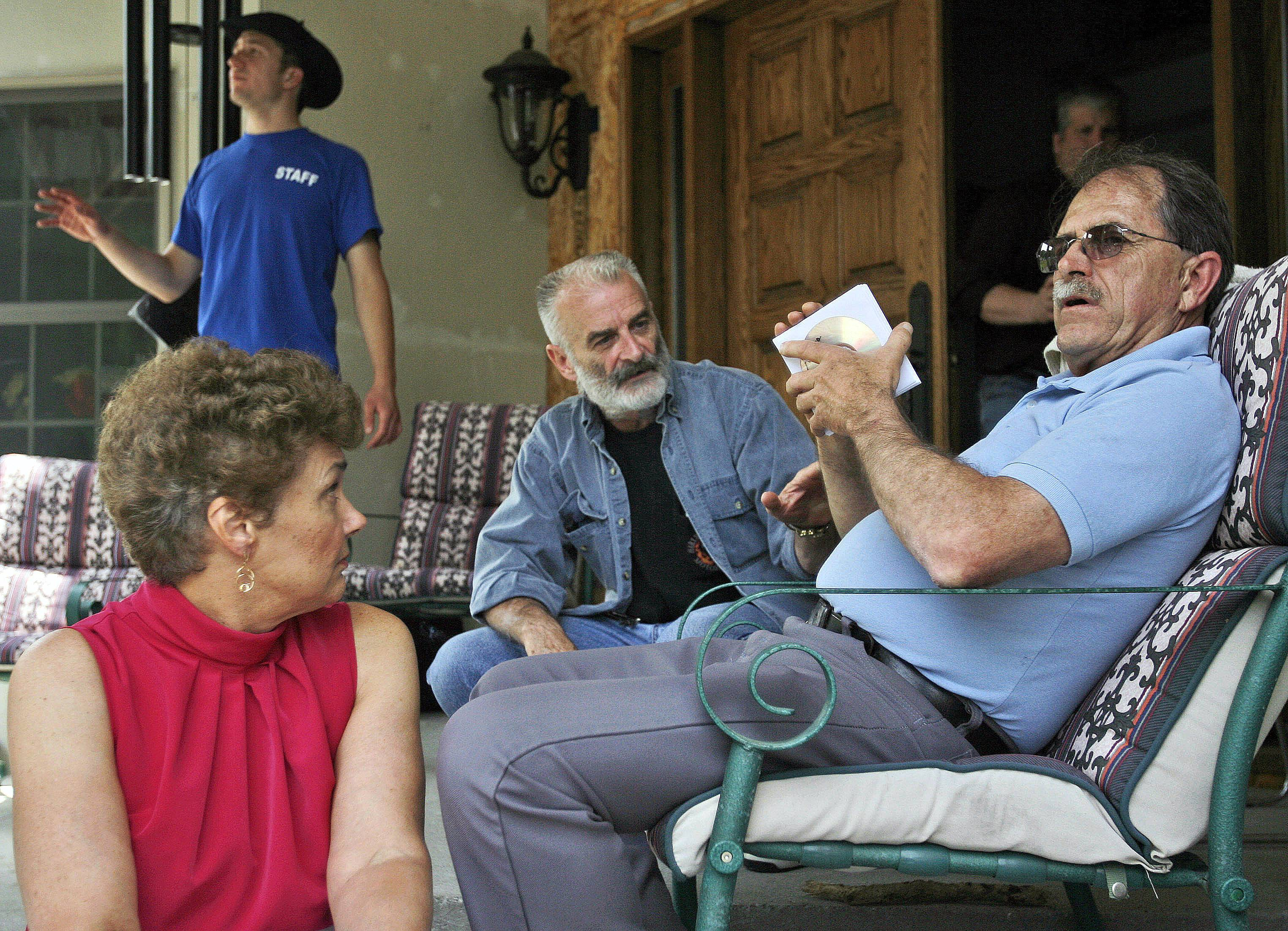 Ed Brown, right, and his wife Elaine Brown listen to Ruby Ridge survivor Randy Weaver, center, at their home in in Plainfield, N.H. The tax-evading couple are serving lengthy sentences after being convicted of amassing an arsenal of weapons and holding law enforcement at bay for nine months in 2007.