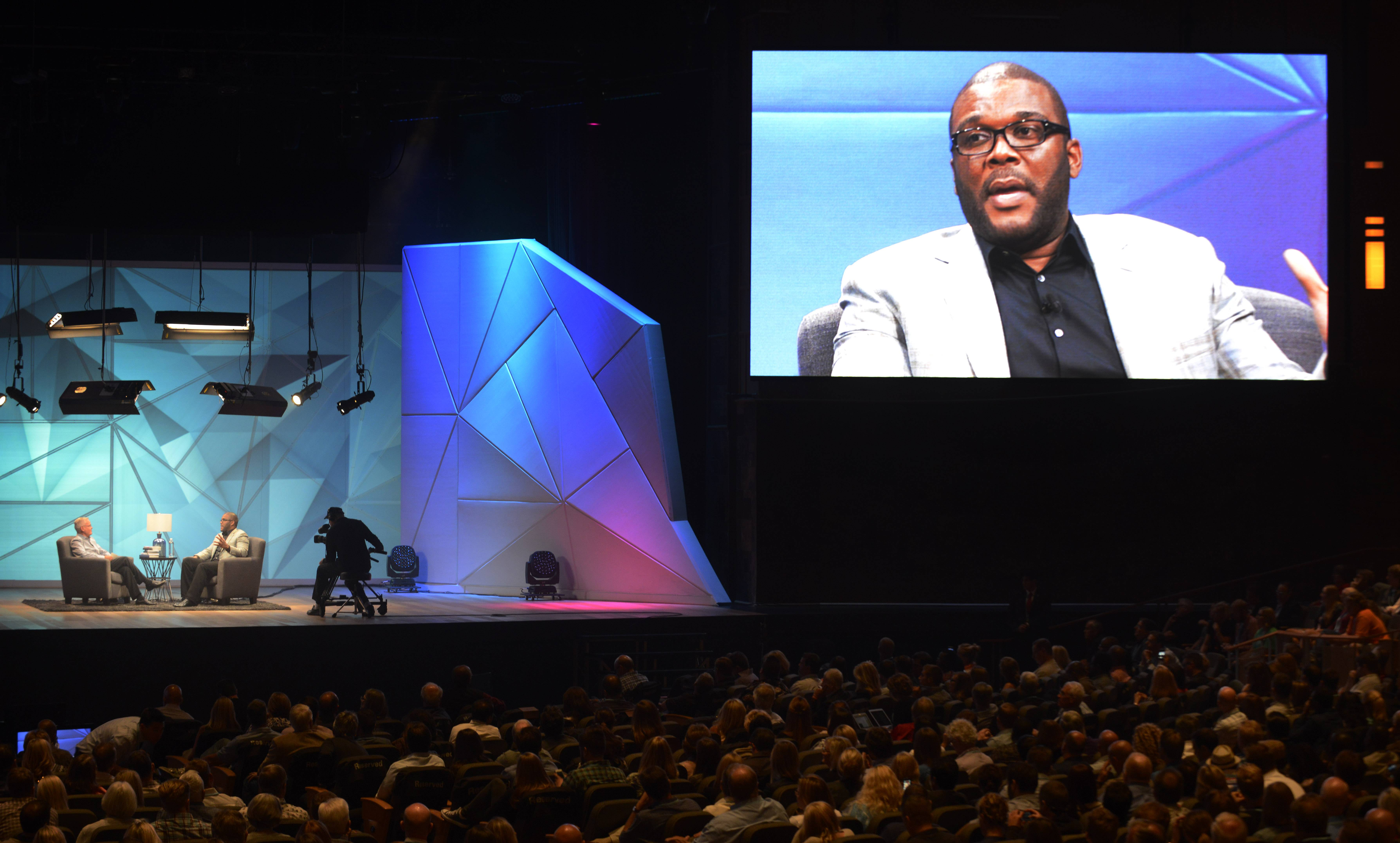 Willow Creek Community Church Senior Pastor Bill Hybels, left, talks with Tyler Perry onstage during the Global Leadership Summit on Friday at the South Barrington church.