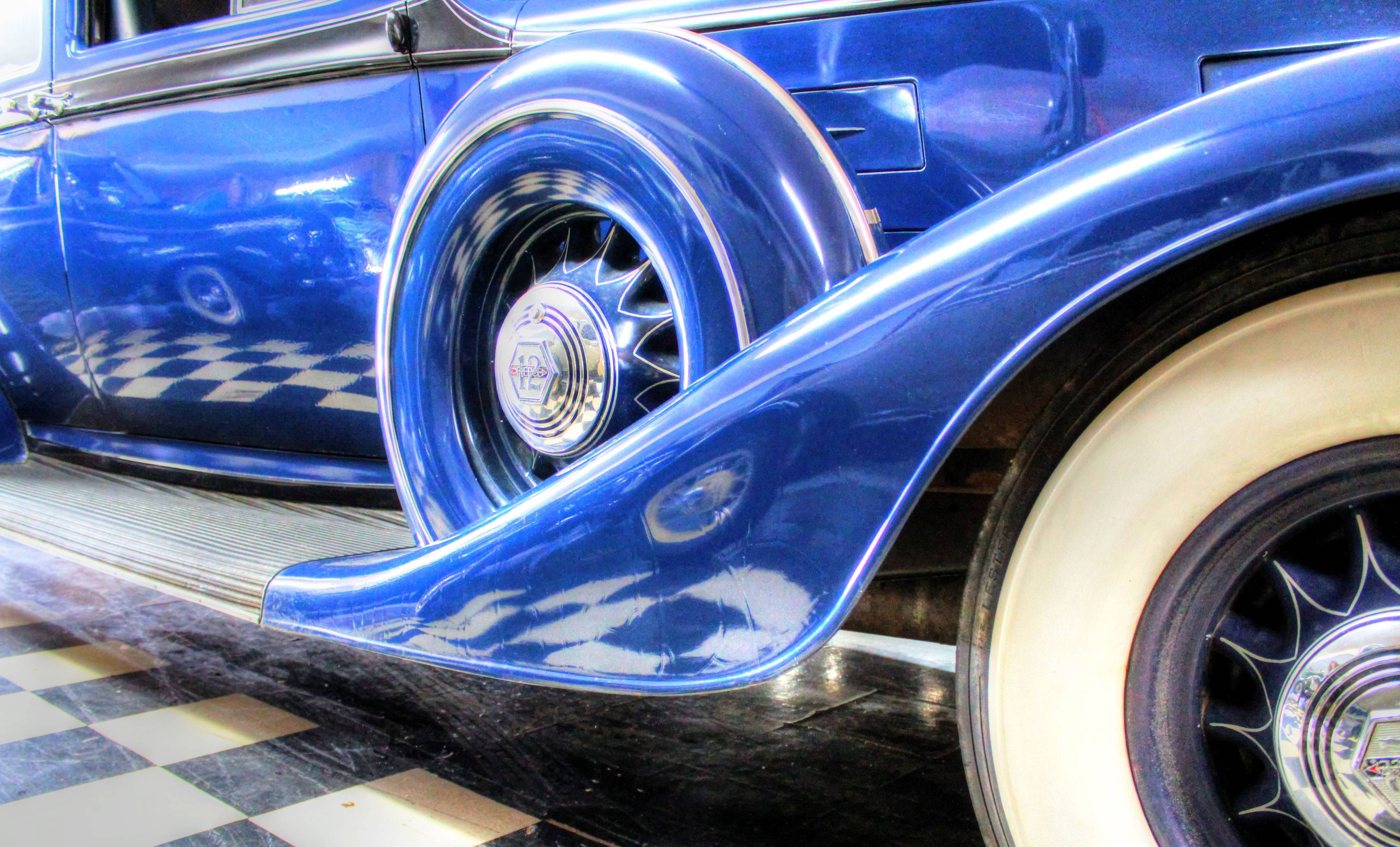 At the Volo Auto Museum, I photographed this car with the checkered floor reflecting off its body. The pattern of the floor distorts and moves with the contours of the car. Another car of similar style can be seen reflected off this car as well. I liked how the photo contains many different elements of pattern and shape as well as good contrast and lighting.