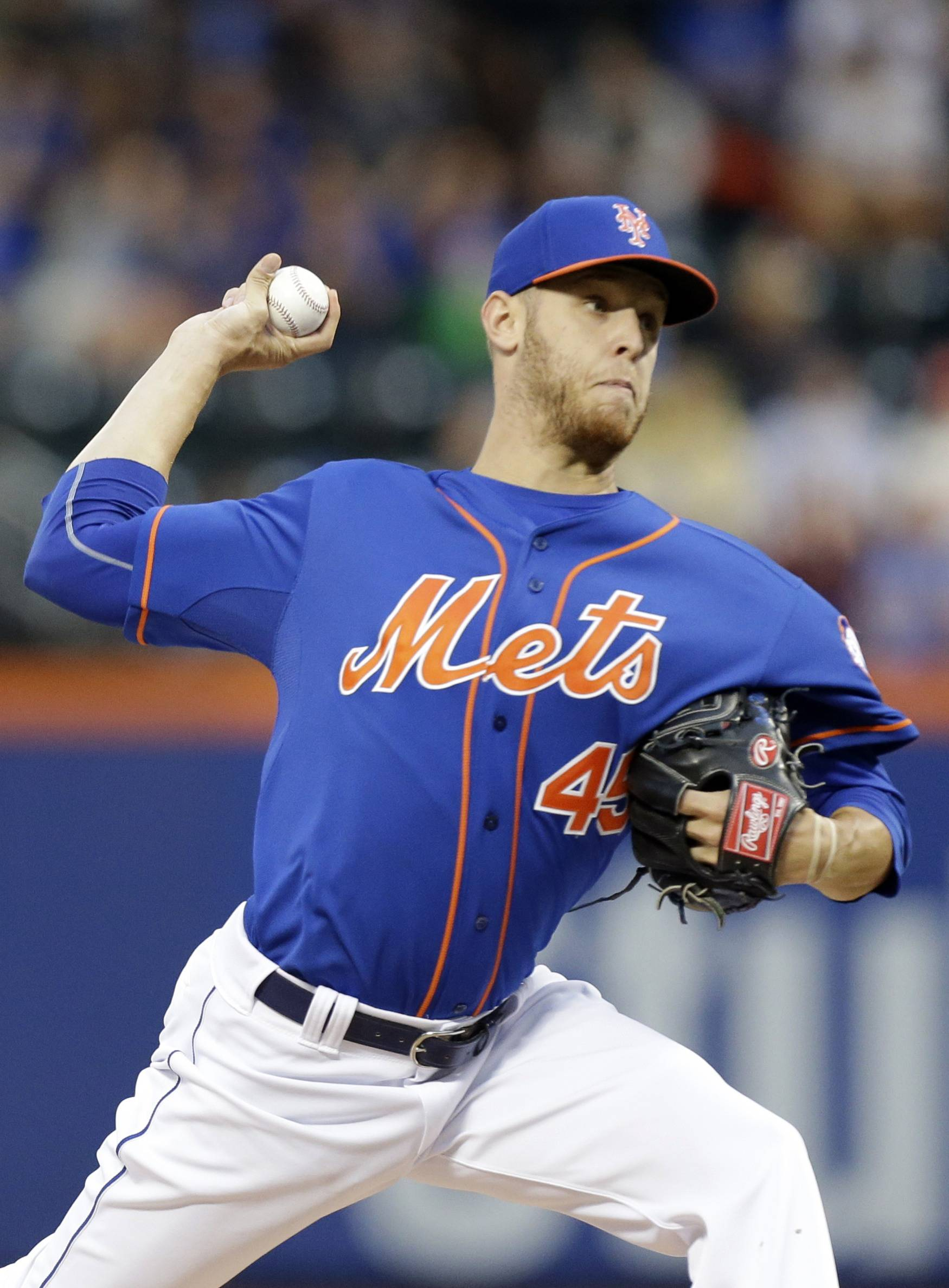 Mets starter Zack Wheeler walked four and hit a batter but overpowered the Cubs on Friday to win his fifth consecutive decision.