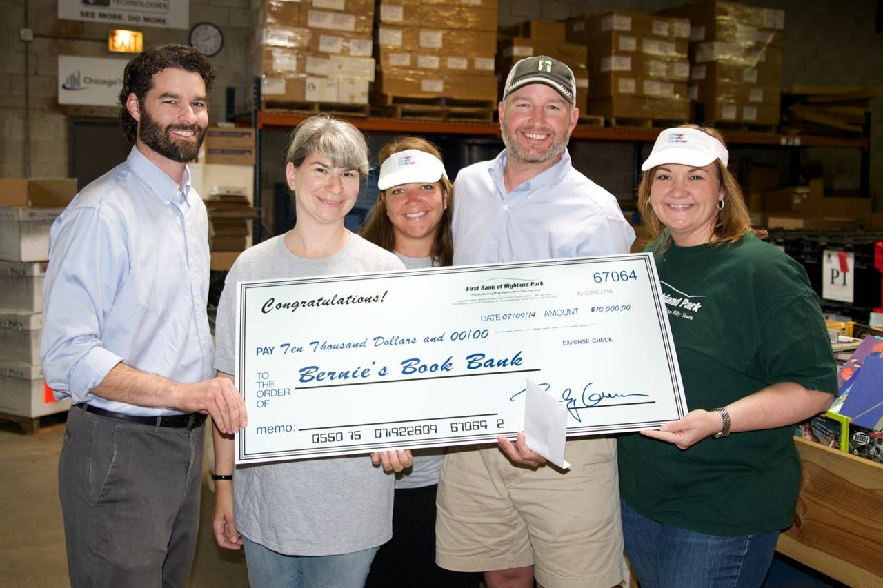 More than 13 employees from First Bank of Highland Park enjoyed an afternoon of volunteering at Bernie's Book Bank  in Lake Forest. At the end of the day, First Bank of Highland Park presented Bernie's Book Bank with a check for $10,000 to help further the organization's mission.Chicago Charity Challenge