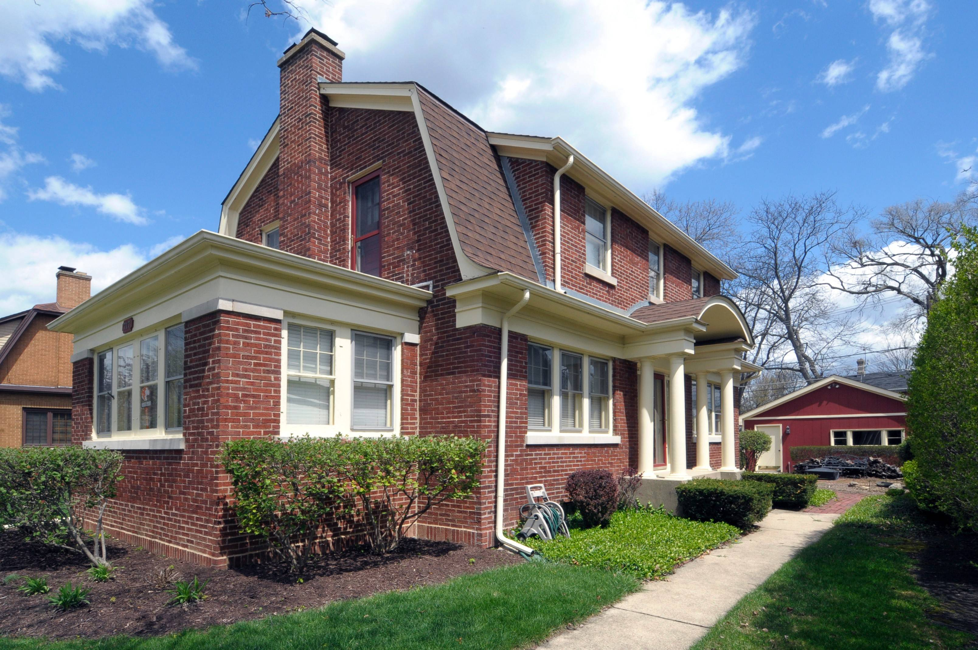 The Dutch Colonial brick home has modern updates and is in downtown Arlington Heights.