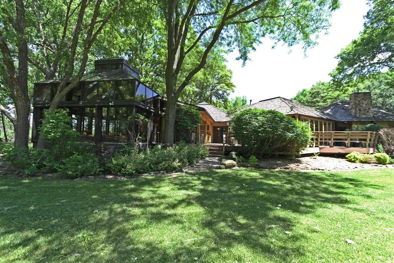 This Barrington home sits on 7 acres with a private lake.