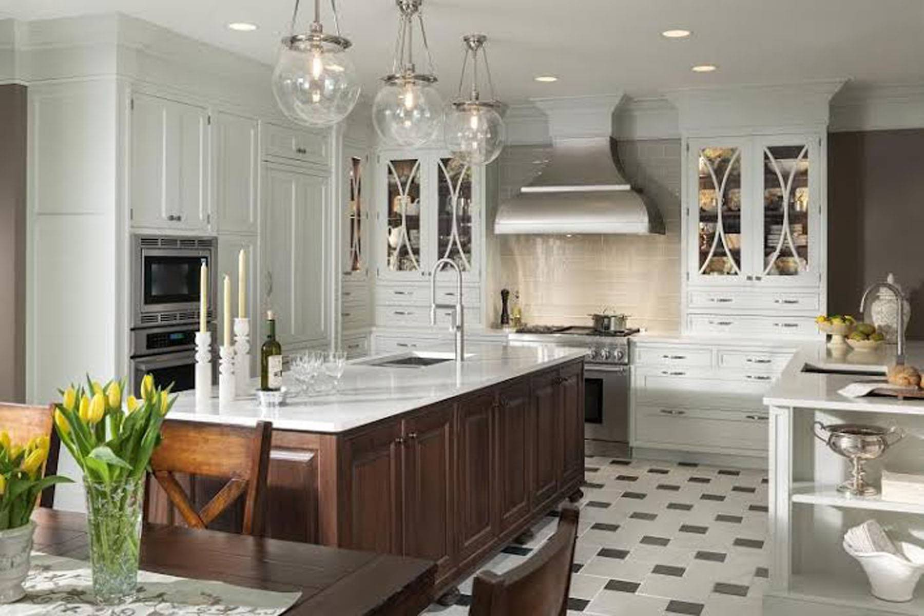 Make mine matchless: A mix of different woods and cabinet styles adds eye appeal to an elegant kitchen.