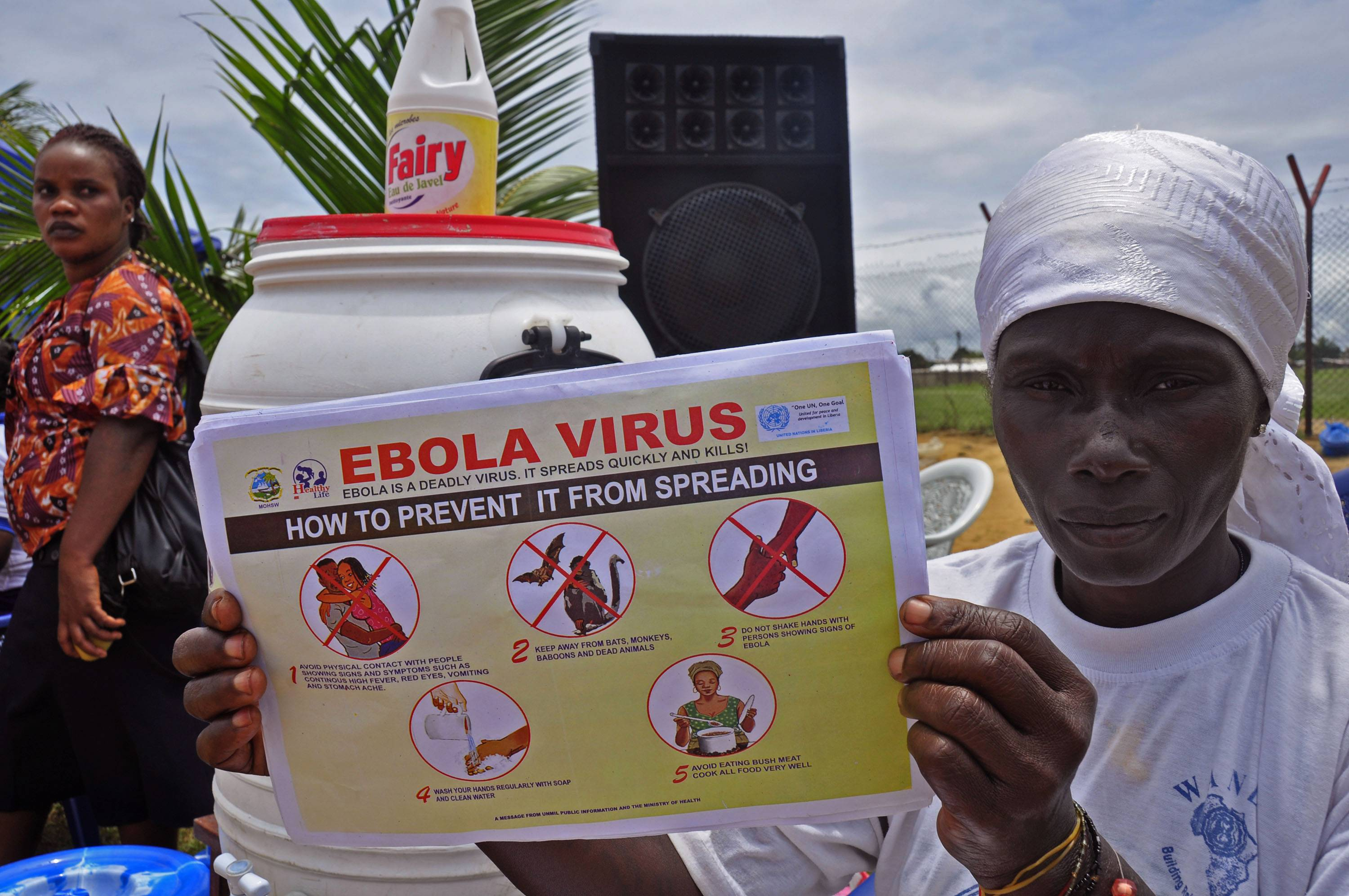 A Liberian woman holds up a pamphlet Thursday with guidance on how to prevent the Ebola virus from spreading.