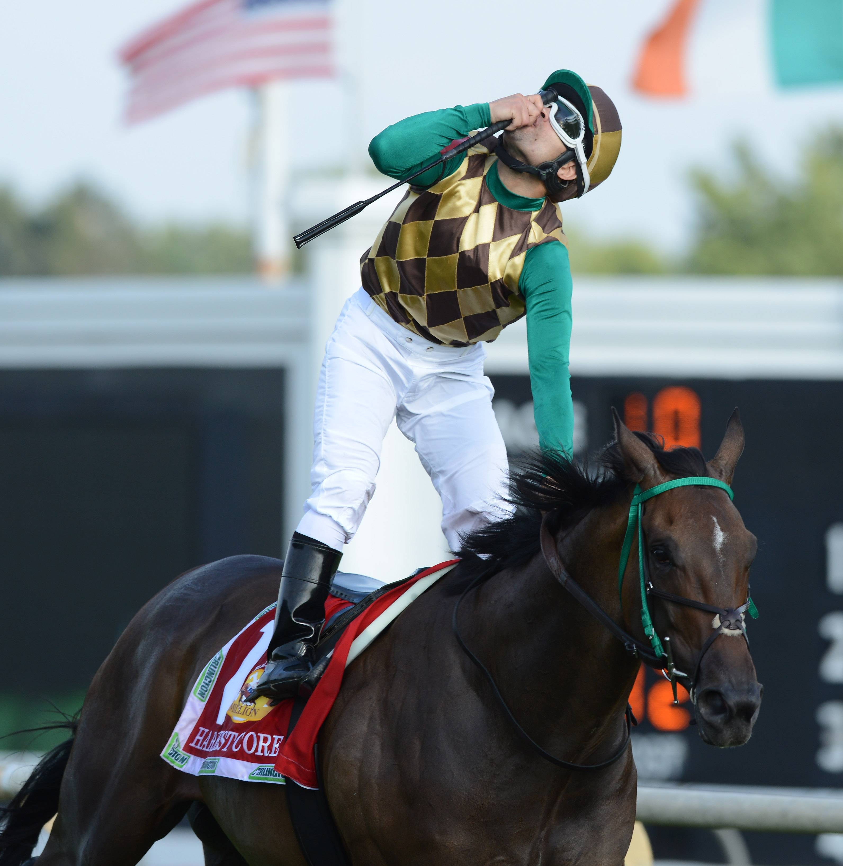 Jockey Eriluis Vaz, aboard Hardest Core, blows a kiss skyward Skyward after winning the Arlington Million.