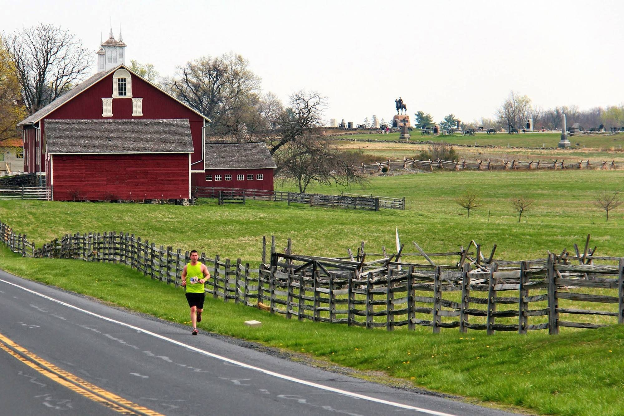 A runner traverses Gettysburg Military Park on the second leg of the 200-mile 2014 American Odyssey Relay. Running is usually seen as a solitary pursuit, but relay races are helping to change that perspective.