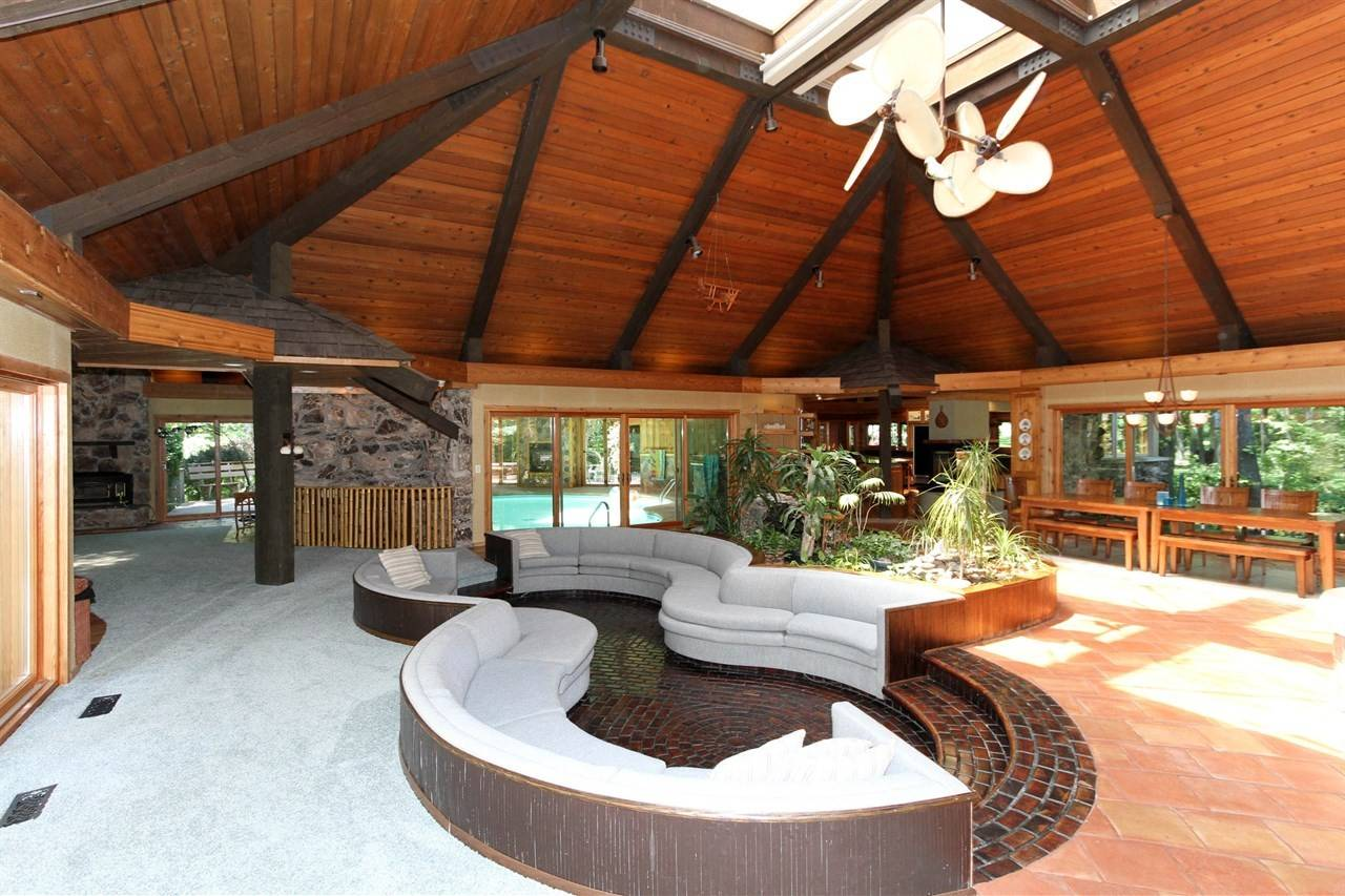 The home, designed by Don Erickson, features a conversation pit in a great room adjacent to an indoor pool.