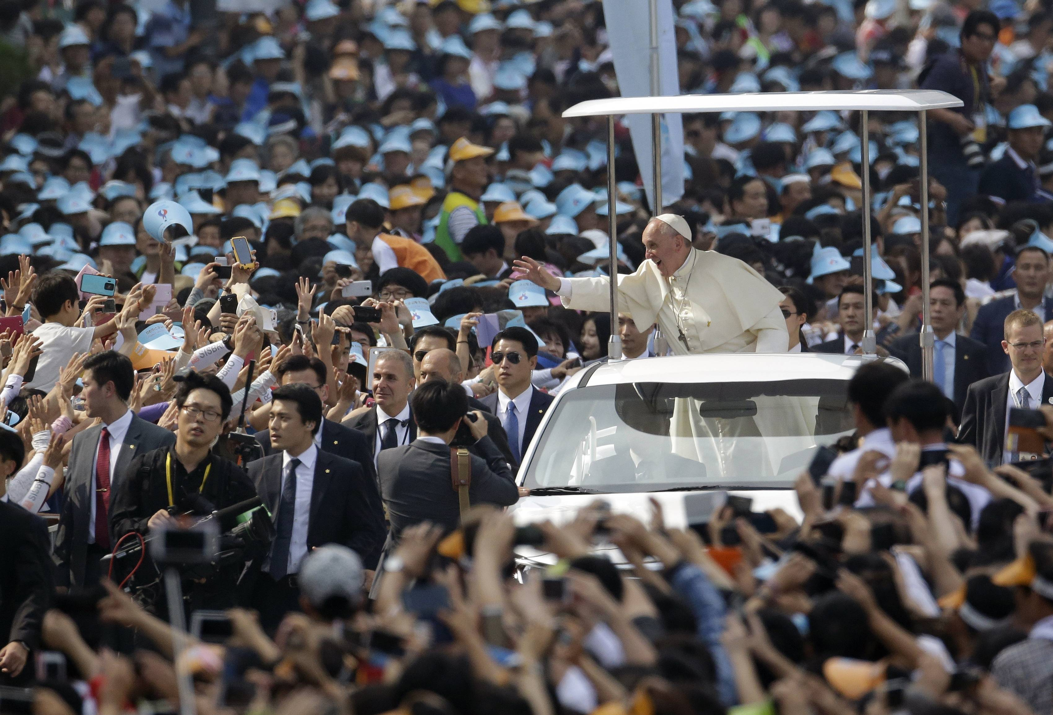Pope Francis is greeted by the faithful Saturday upon his arrival for the beatification mass of Paul Yun Ji-Chung and his 123 martyr companions.