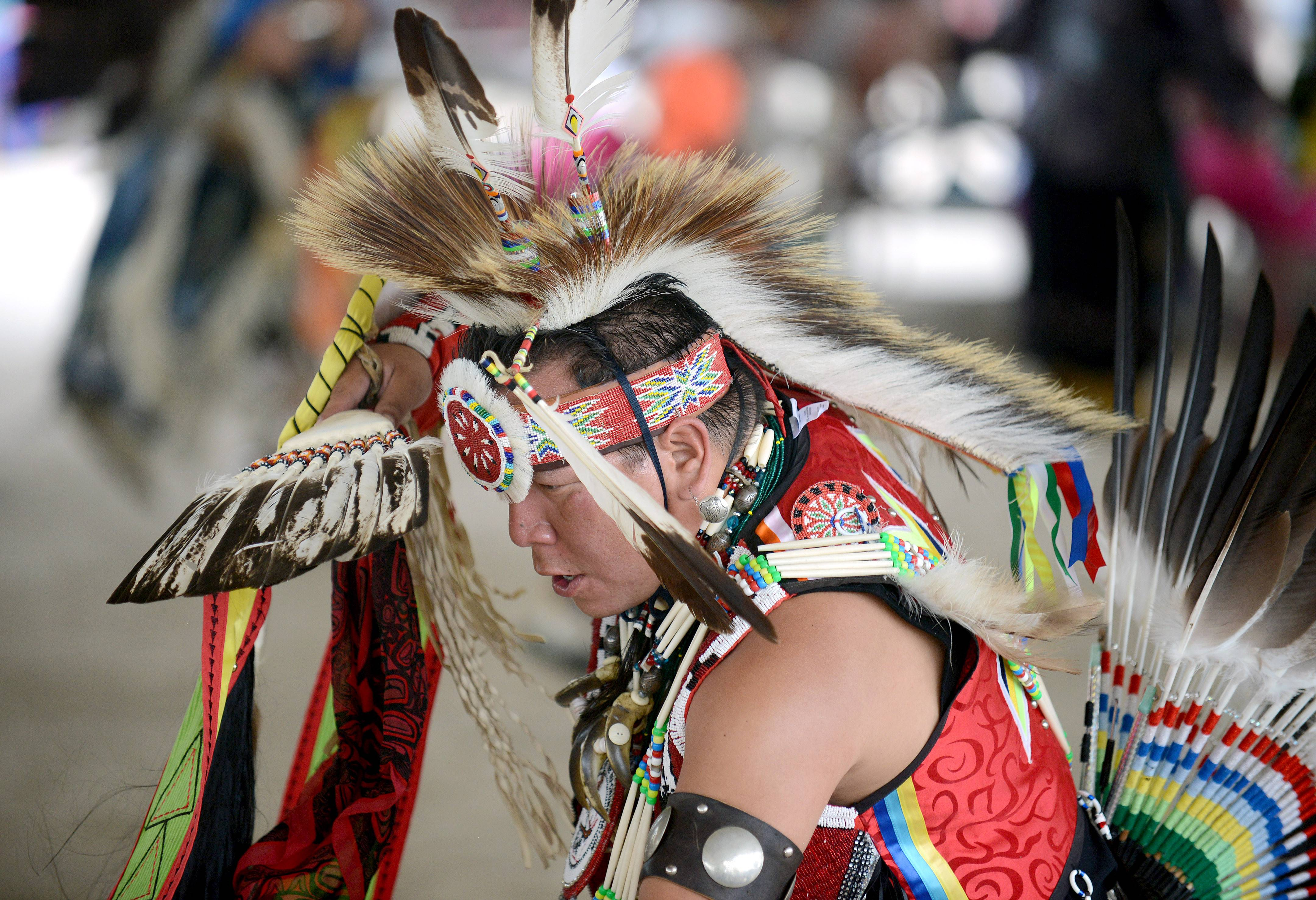Evan Logan of the Ho-Chunk Nation and Wisconsin Dells, Wis., dances during the Pow Wow at the Festival of the Horse and Drum at the Kane County Fairgrounds in St. Charles Saturday. He has been dancing for about 35 years.