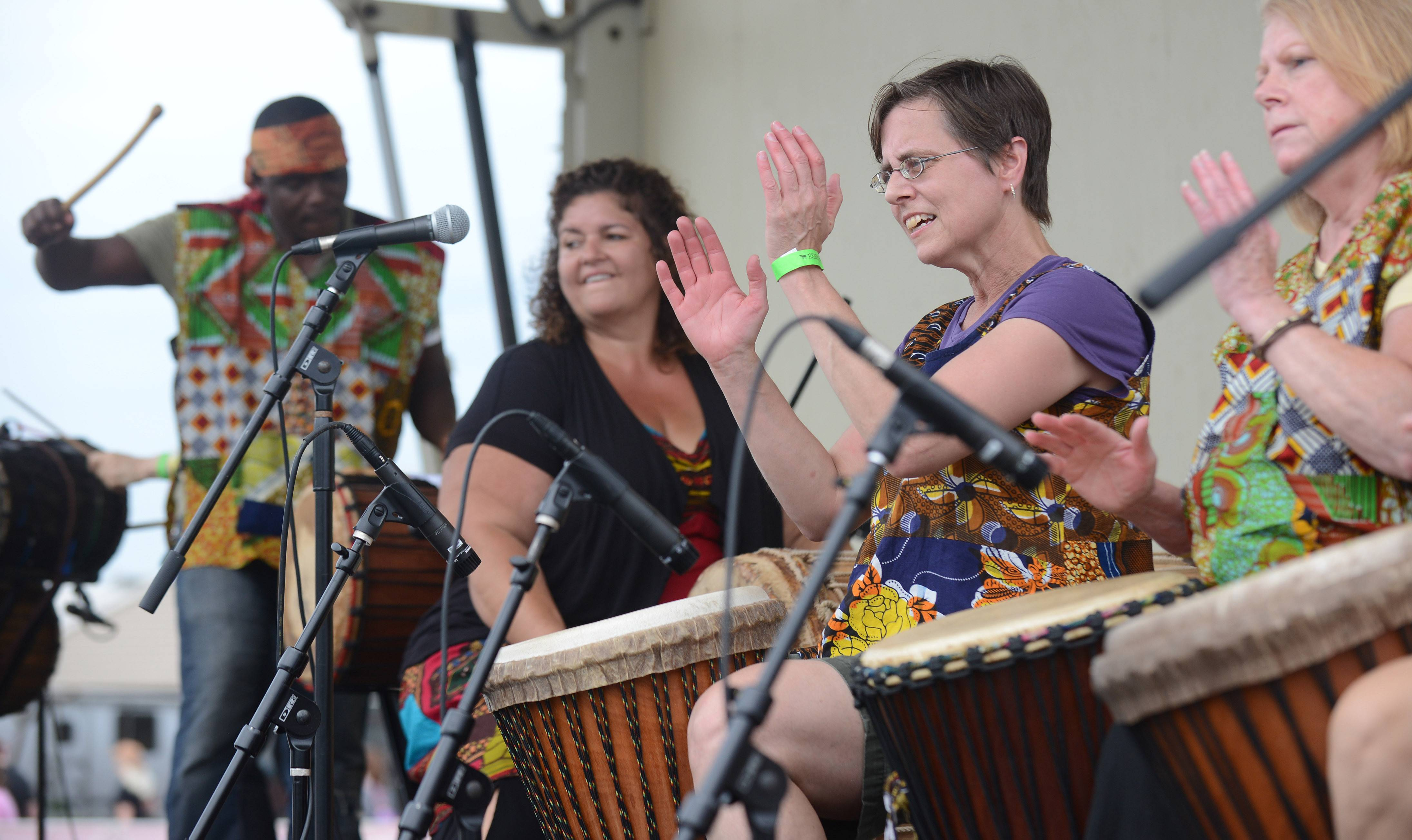Amy Lusk of Chicago, center, performs with the Diamana Diya West African drum ensemble at the Festival of the Horse and Drum at the Kane County Fairgrounds in St. Charles Saturday.