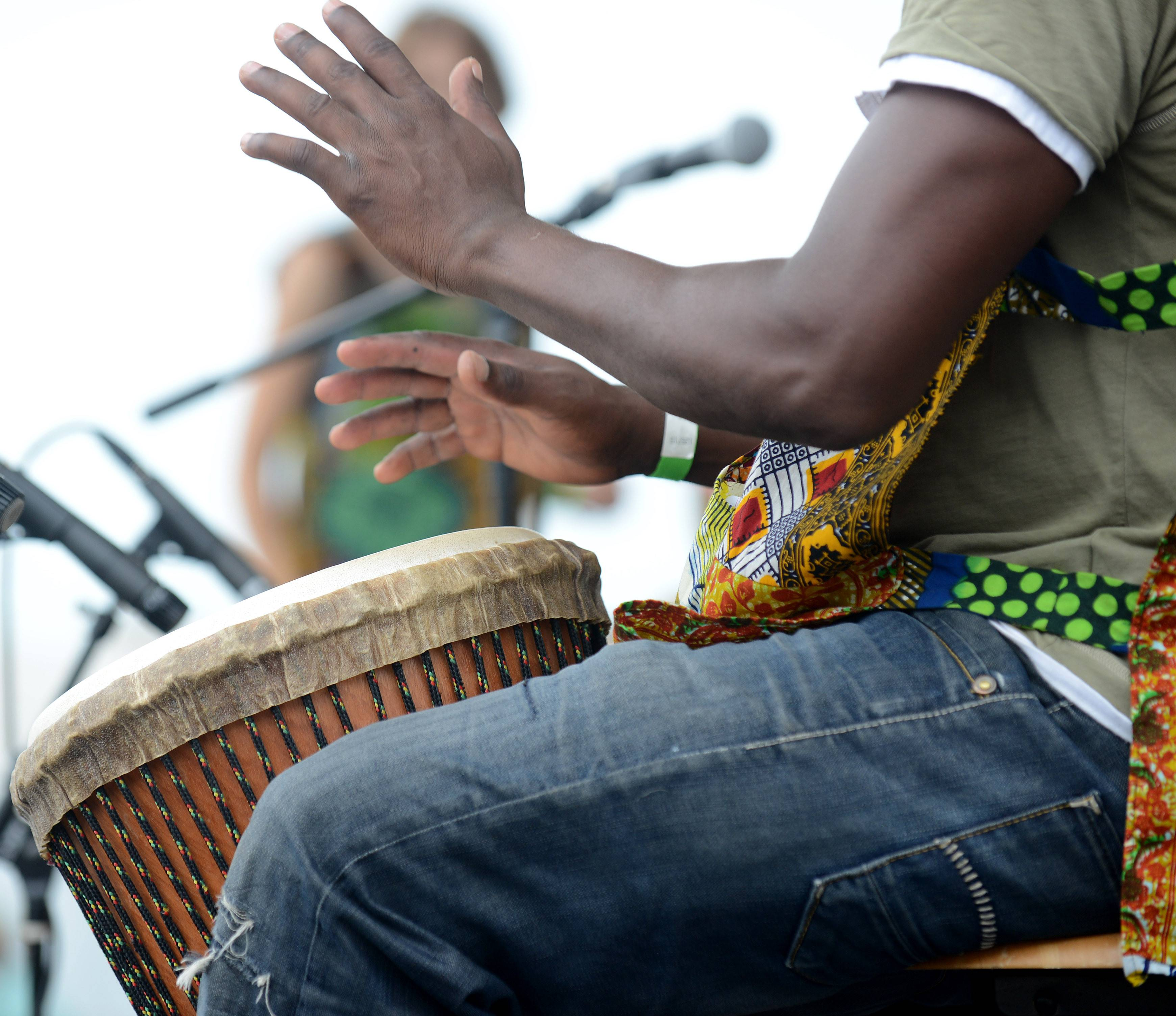 Fode Camara of West Africa performs with the West African drum ensemble Diamana Diya at the Festival of the Horse and Drum at the Kane County Fairgrounds in St. Charles Saturday.