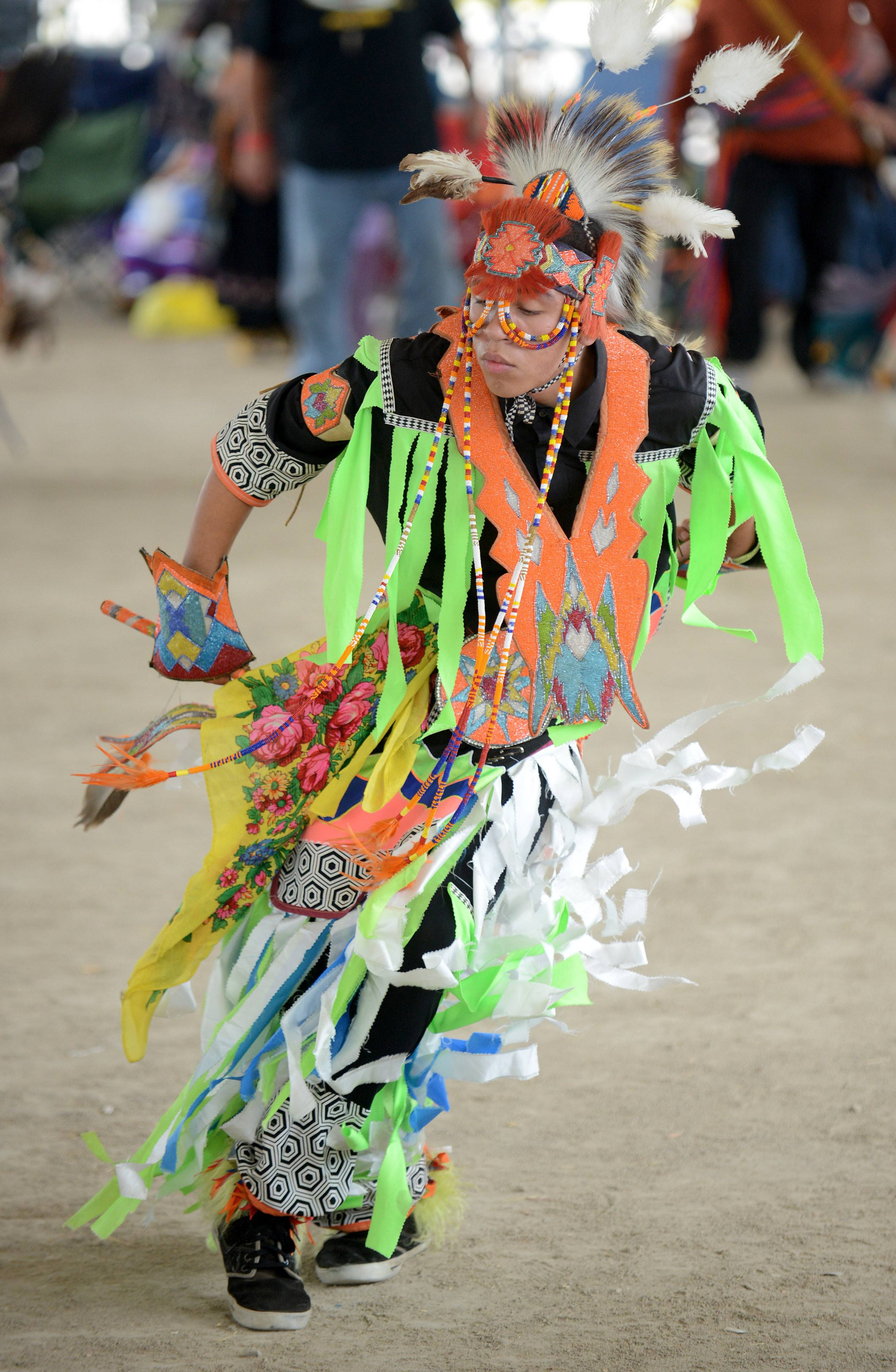 Adam Walter, 17, of the Ho-Chunk Nation and Tomah, Wis., dances in the Pow Wow at the Festival of the Horse and Drum at the Kane County Fairgrounds Saturday.
