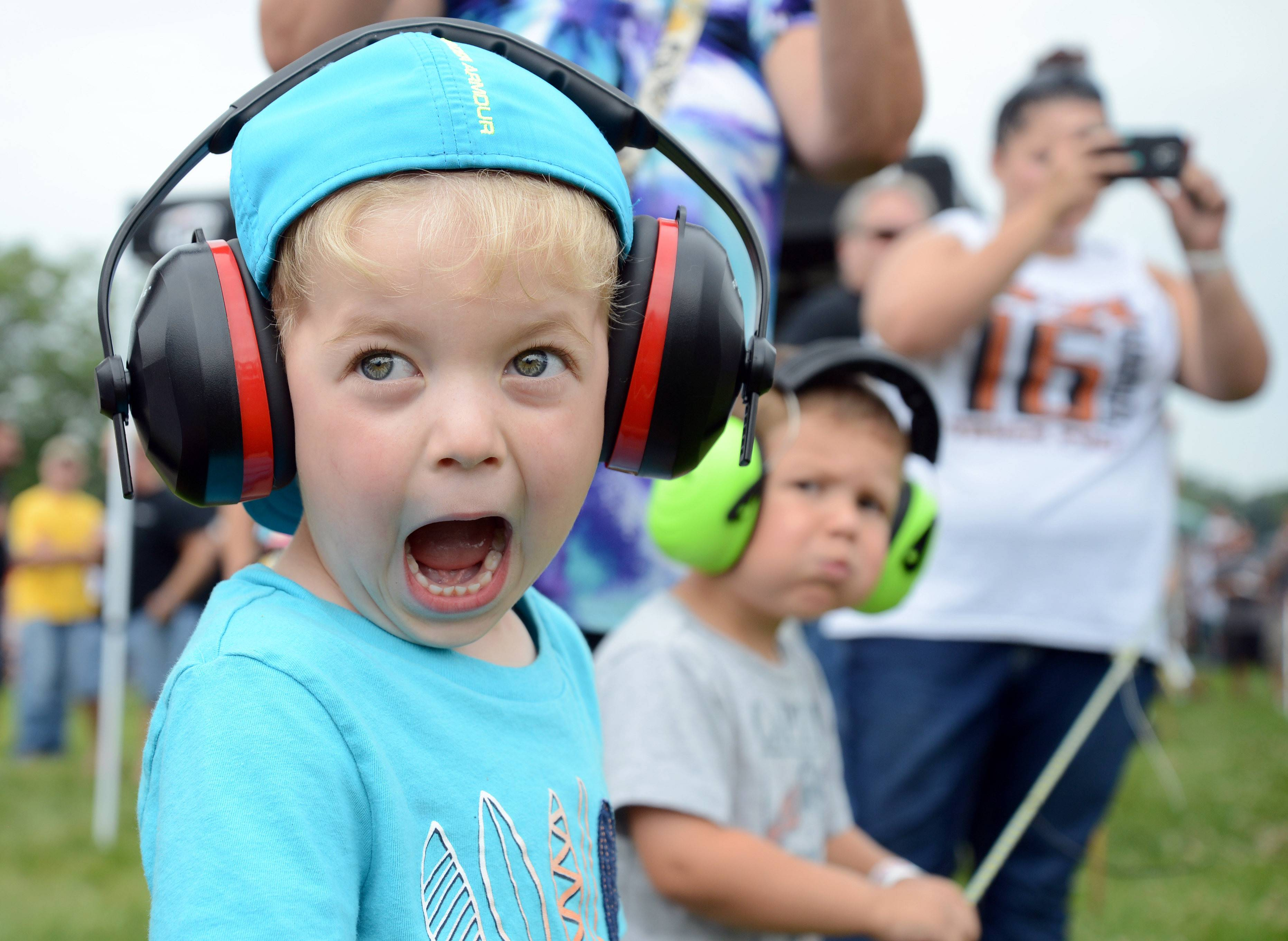 Rustin Angerola, 3, of Elburn reacts as a truck in the 6,500 AS 4 x 4 class takes off from the starting line at the truck and tractor pull at Elburn Days Saturday. His friend and neighbor, Hayden Deutsch, 3, is on the right.